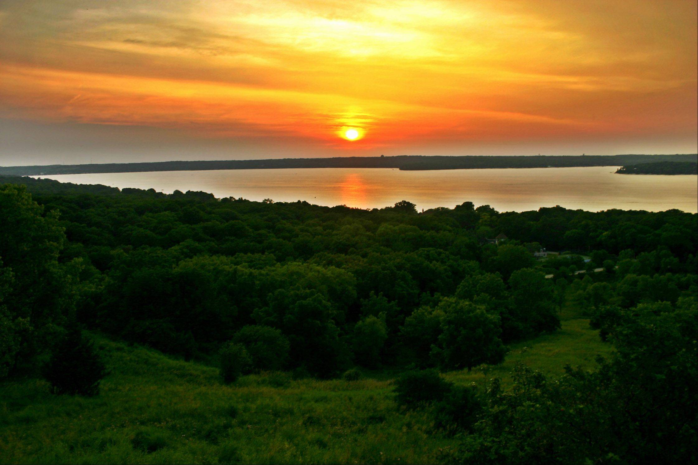 The sun sets over Lake Geneva, WI near Majestic Ski Hill this past summer.