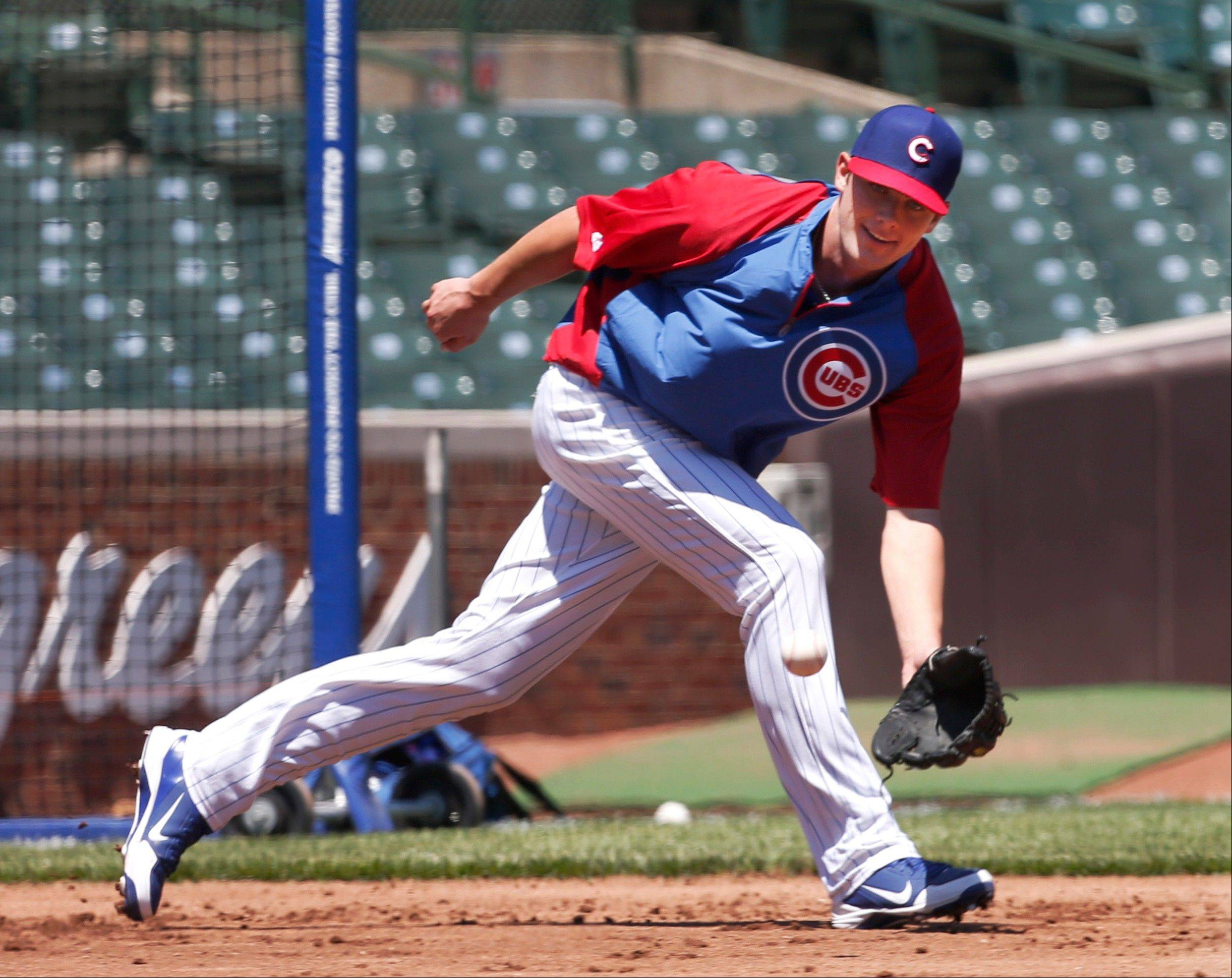"Kris Bryant takes fielding practice at third during batting practice before the Cubs lost to St. Louis on Friday at Wrigley Field. Bryant, the No. 2 overall pick in the draft, said he's ""very happy to be a Cub."""
