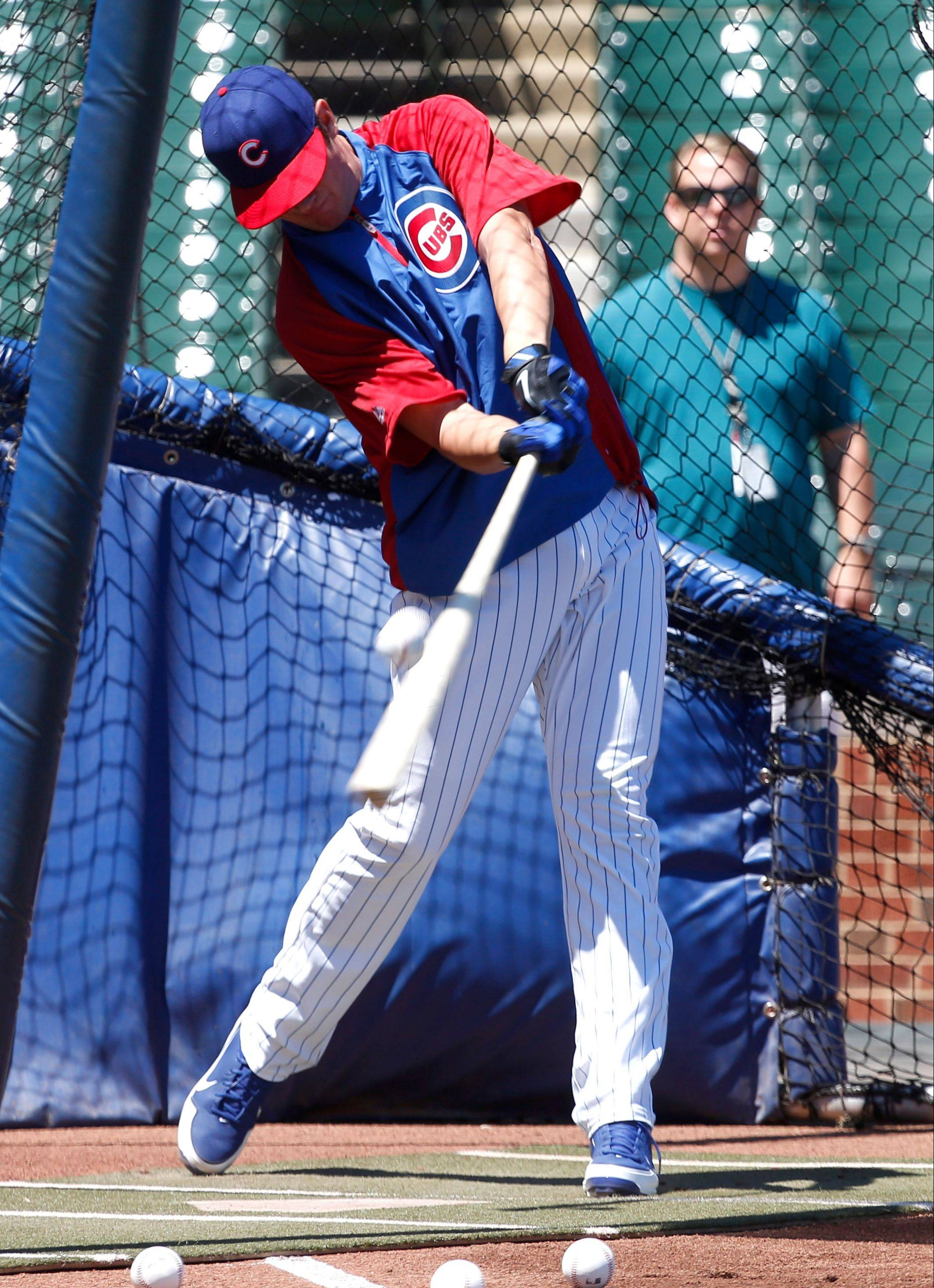 "Cubs' first-round draft pick Kris Bryant takes batting practice before the Cubs lost to St. Louis on Friday at Wrigley Field. Bryant, the No. 2 overall pick in the draft, said he's ""very happy to be a Cub."""