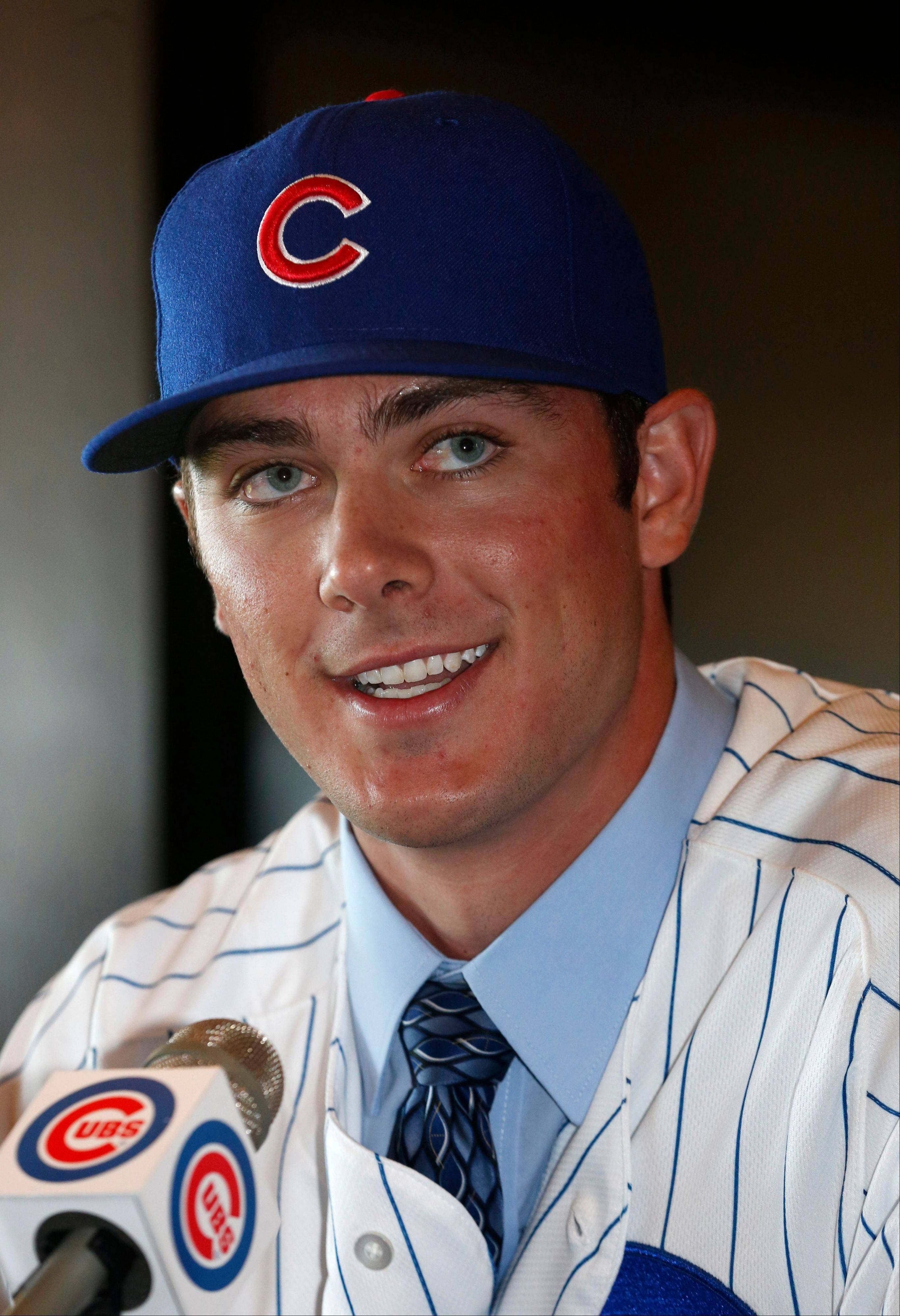 Kris Bryant smiles during a news conference where he was introduced to the media on Friday at Wrigley Field.