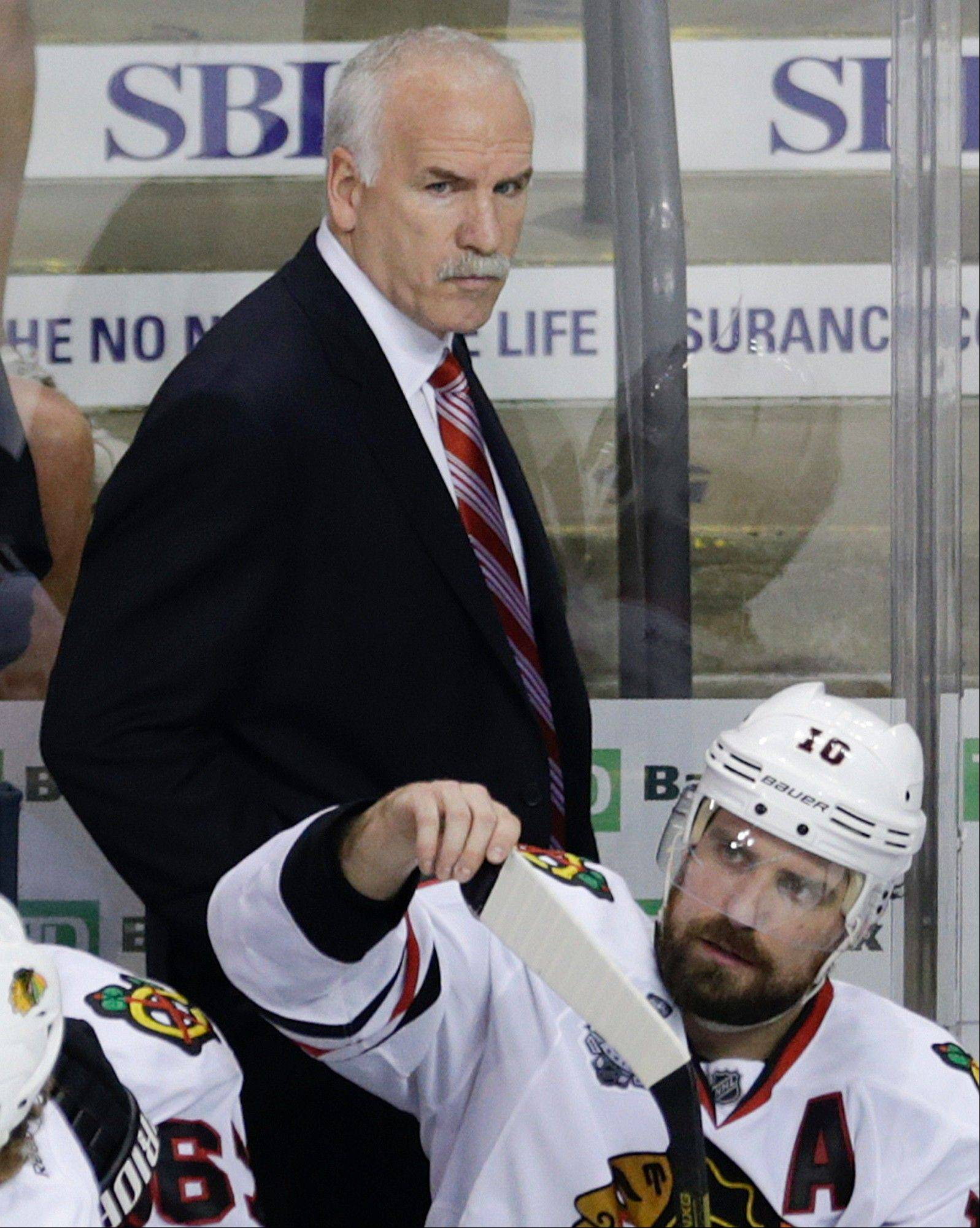 Chicago Blackhawks head coach Joel Quenneville walks behind the bench during the second period in Game 6 of the NHL hockey Stanley Cup Finals against the Boston Bruins, Monday, June 24, 2013, in Boston.