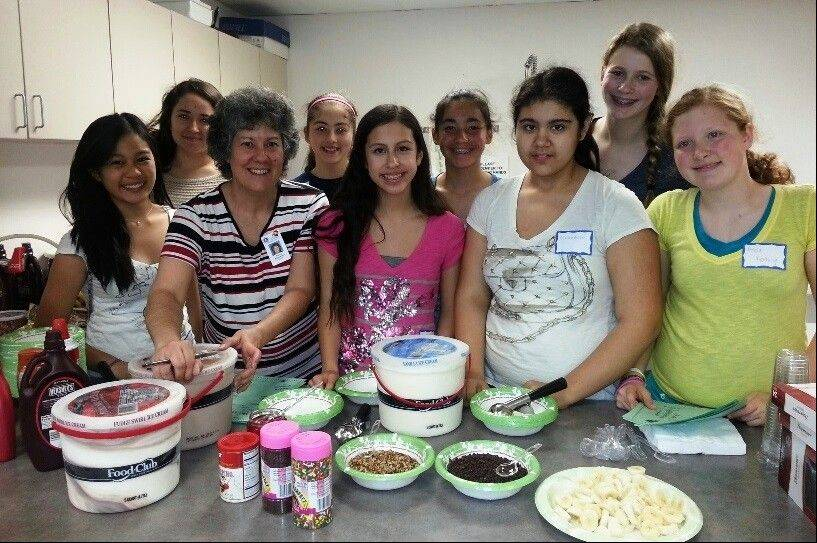 The Sundling Junior High School Builders Club hosted an Ice Cream Social at the Palatine Township Senior Center on May 20. Club members pictured at the event, from left, are: Front row: Patty Arcangel, Mrs. Nancy Biancalana, Ashley Vallejo, Guadalupe Talavera and Anna Froeling; back row: Karen Contreras, Galilea Lujano, Sarah Gonwa and Claire Chaplinsky.