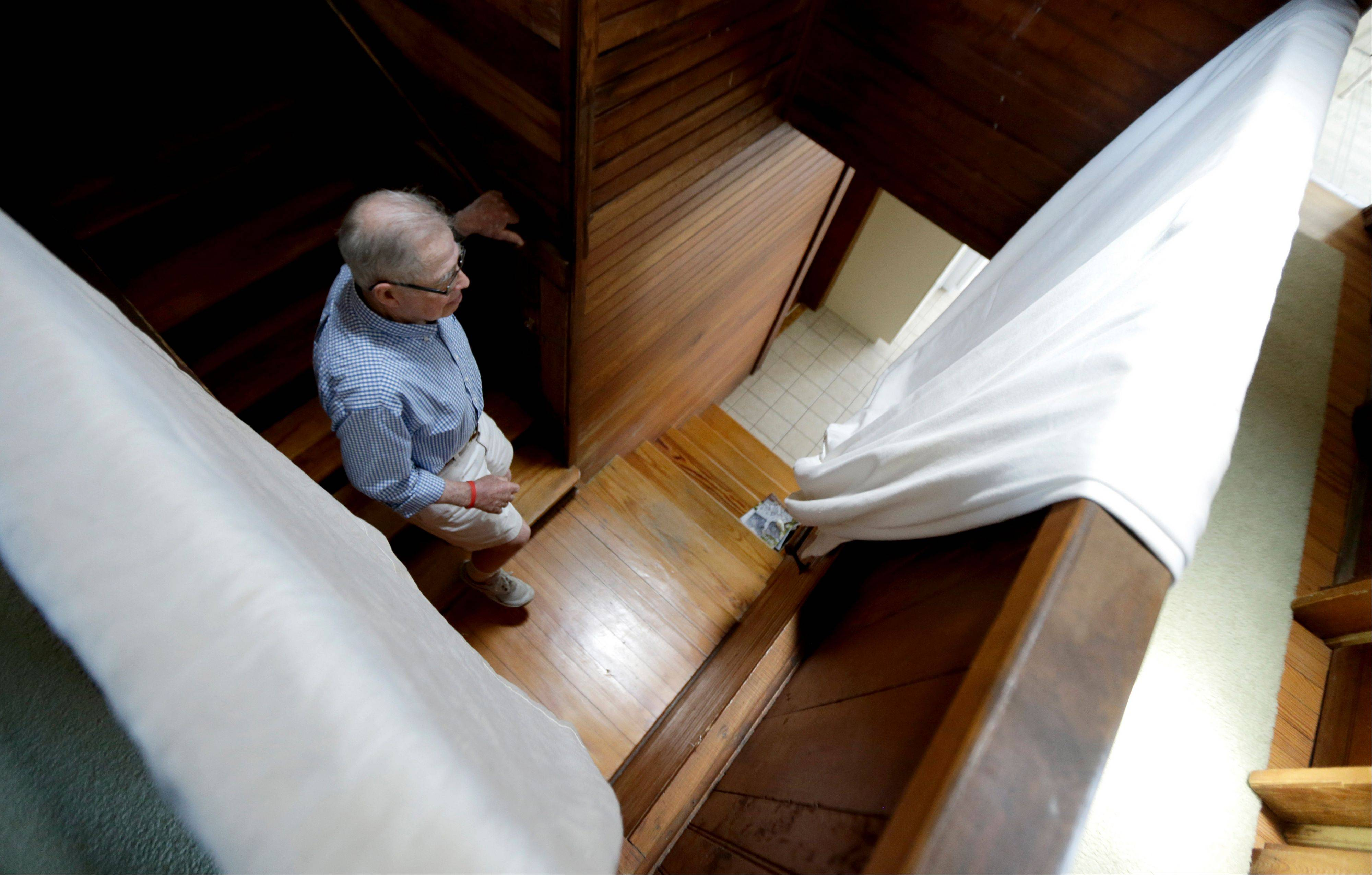 Robert Post, 85, walks down the stairs in his home, in Mantoloking, N.J., which was flooded during Superstorm Sandy last year. Post has a pacemaker that needs to be checked once a month by phone, but the phone company refuses to restore the area�s landlines after they were damaged by the storm because it says phone lines are outdated.