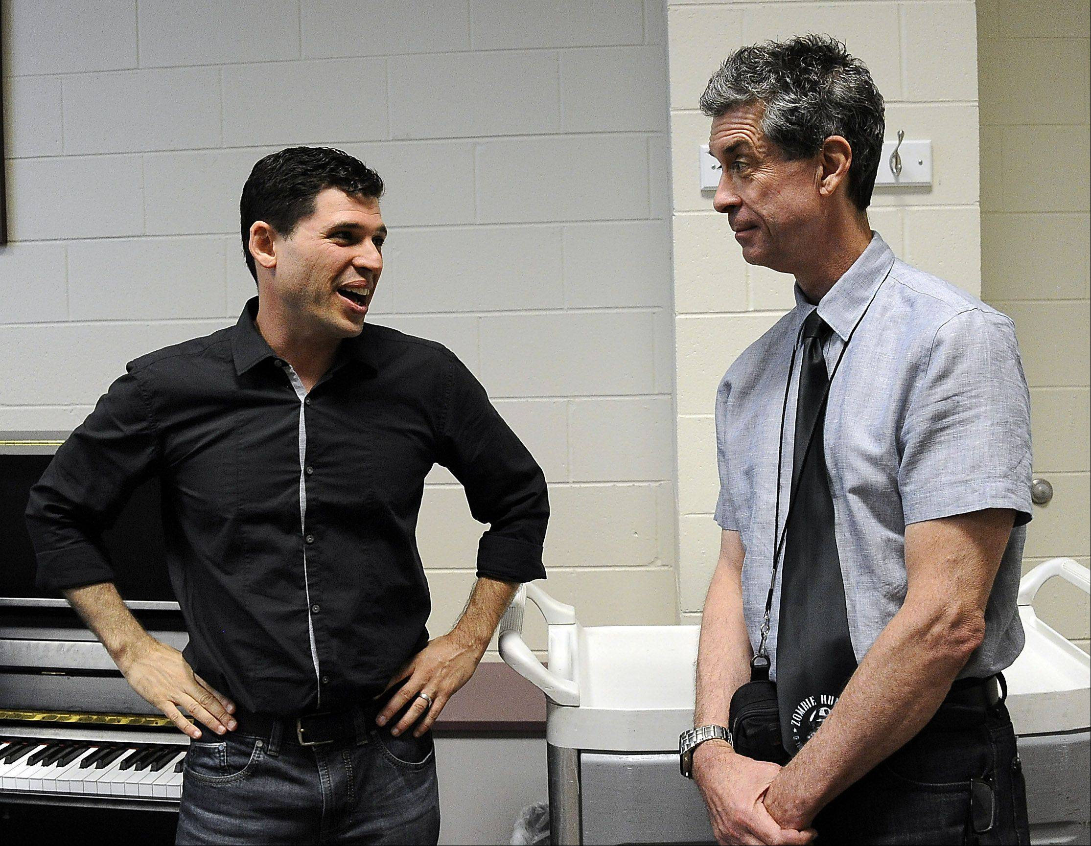 Daily Herald film critic Dann Gire (right) talks with Max Brooks, writer of the best-seller �World War Z: An Oral History of the Zombie Wars,� at Harper College before Brooks speaking engagement to a packed house about the undead phenomena.