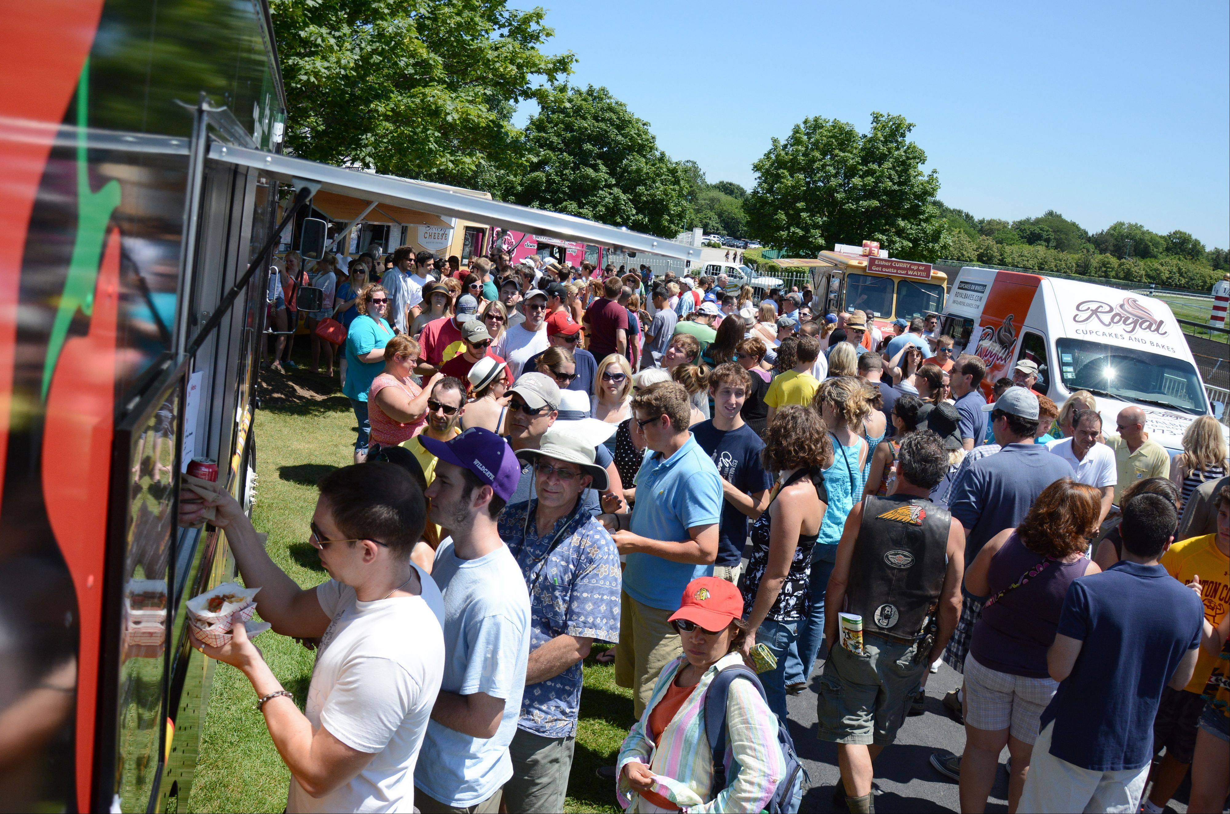 Crowds flock to the Food Truck Festival at Arlington Park on Saturday.
