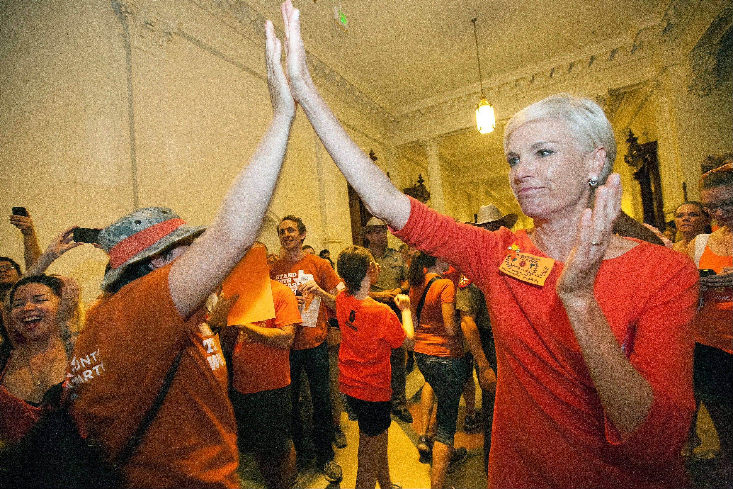 Cecile Richards, daughter of former Texas Gov. Ann Richards and President of Planned Parenthood Action Fund, greets abortion rights advocates Friday as they leave the State Capitol rotunda in Austin, Texas. Democrats plan to use the GOP decision to pass possibly the strictest anti-abortion laws in the country during the next election.
