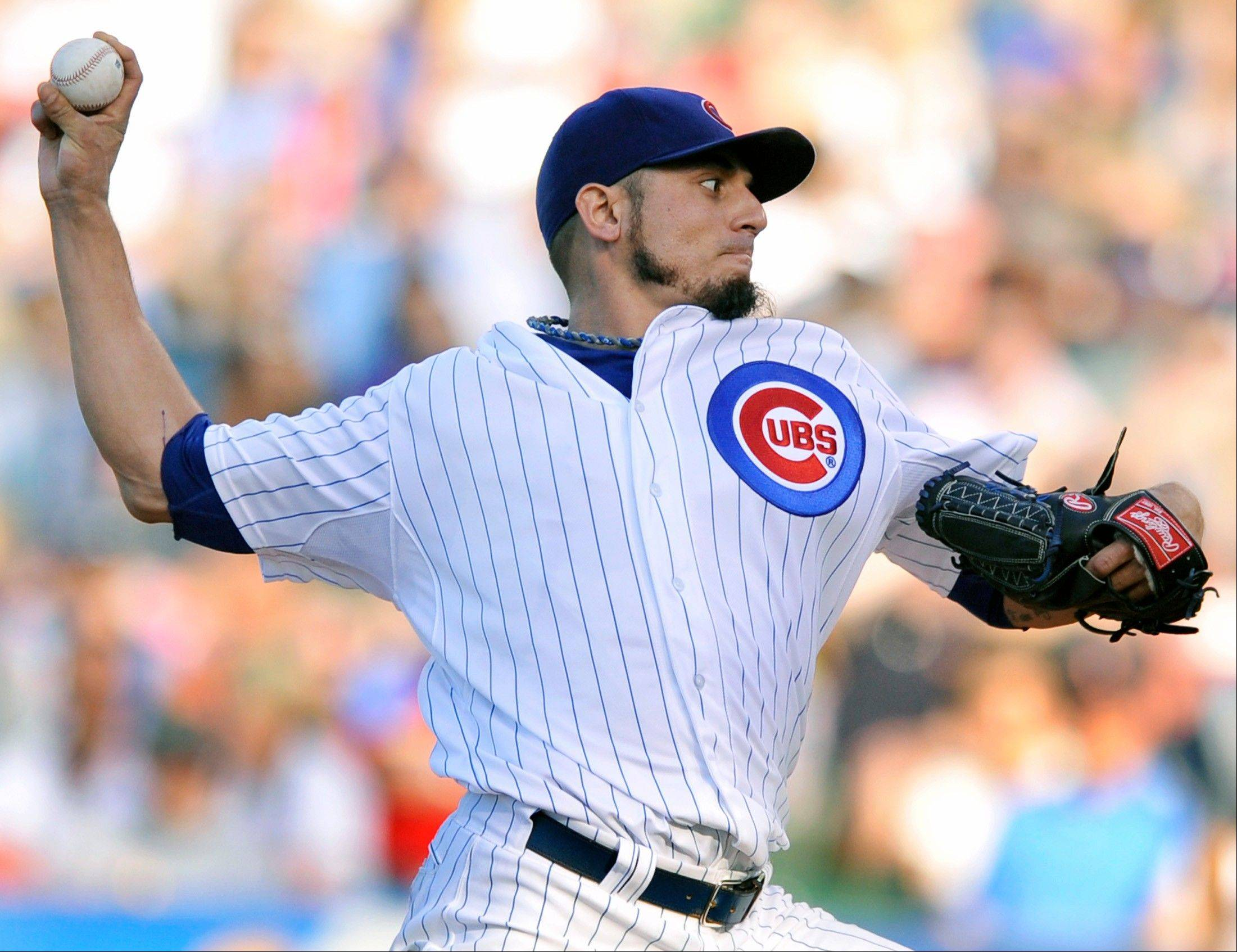 Cubs starter Matt Garza delivers a pitch during the first inning Saturday against the Cardinals at Wrigley Field.