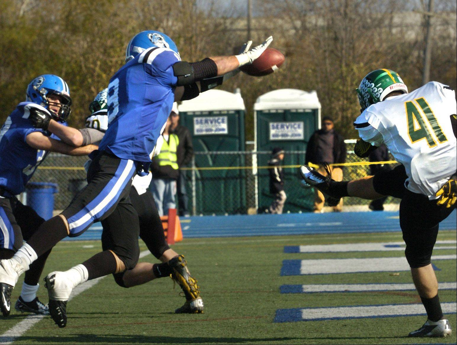 Colton Moskal of Lake Zurich blocks a Crystal Lake South punt for a safety in the first half of the Class 7A state playoff opener.