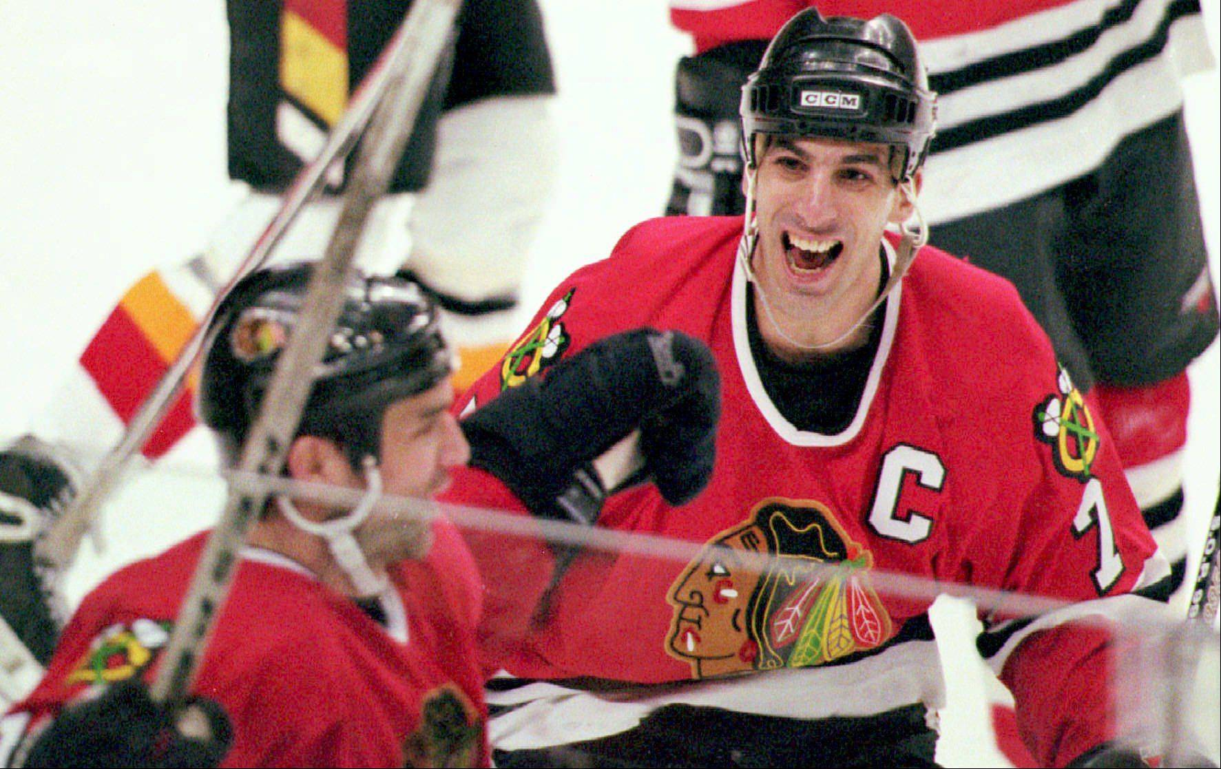 @$ID/[No paragraph style]:Blackhawks captain Chris Chelios congratulates teammate Joe Murphy in this April 24, 1996, photo.