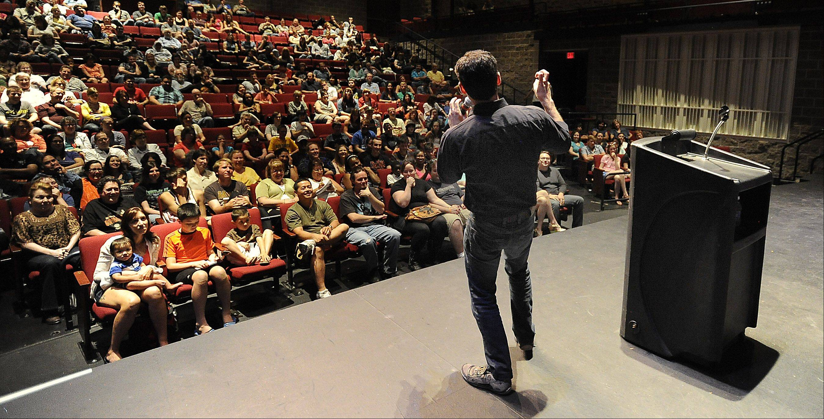"Max Brooks, writer of the best-seller ""World War Z: An Oral History of the Zombie Wars,"" speaks to a packed house at Harper College. He was talking about the undead phenomena that has taken the country by storm."