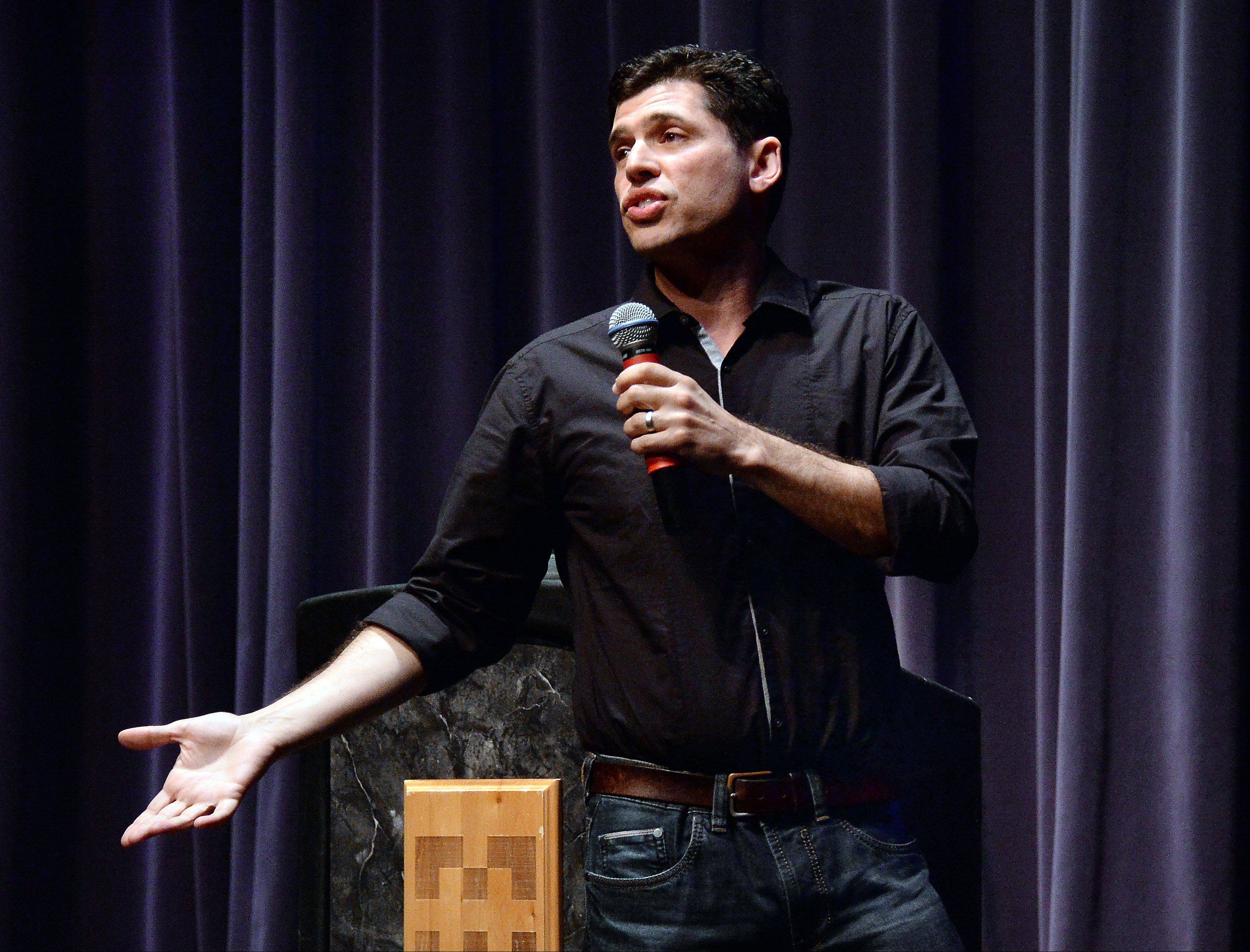"Max Brooks, writer of the best-seller ""World War Z: An Oral History of the Zombie Wars,"" speaks Friday to a packed house at Harper College. He was talking about the undead phenomena that has taken the country by storm."