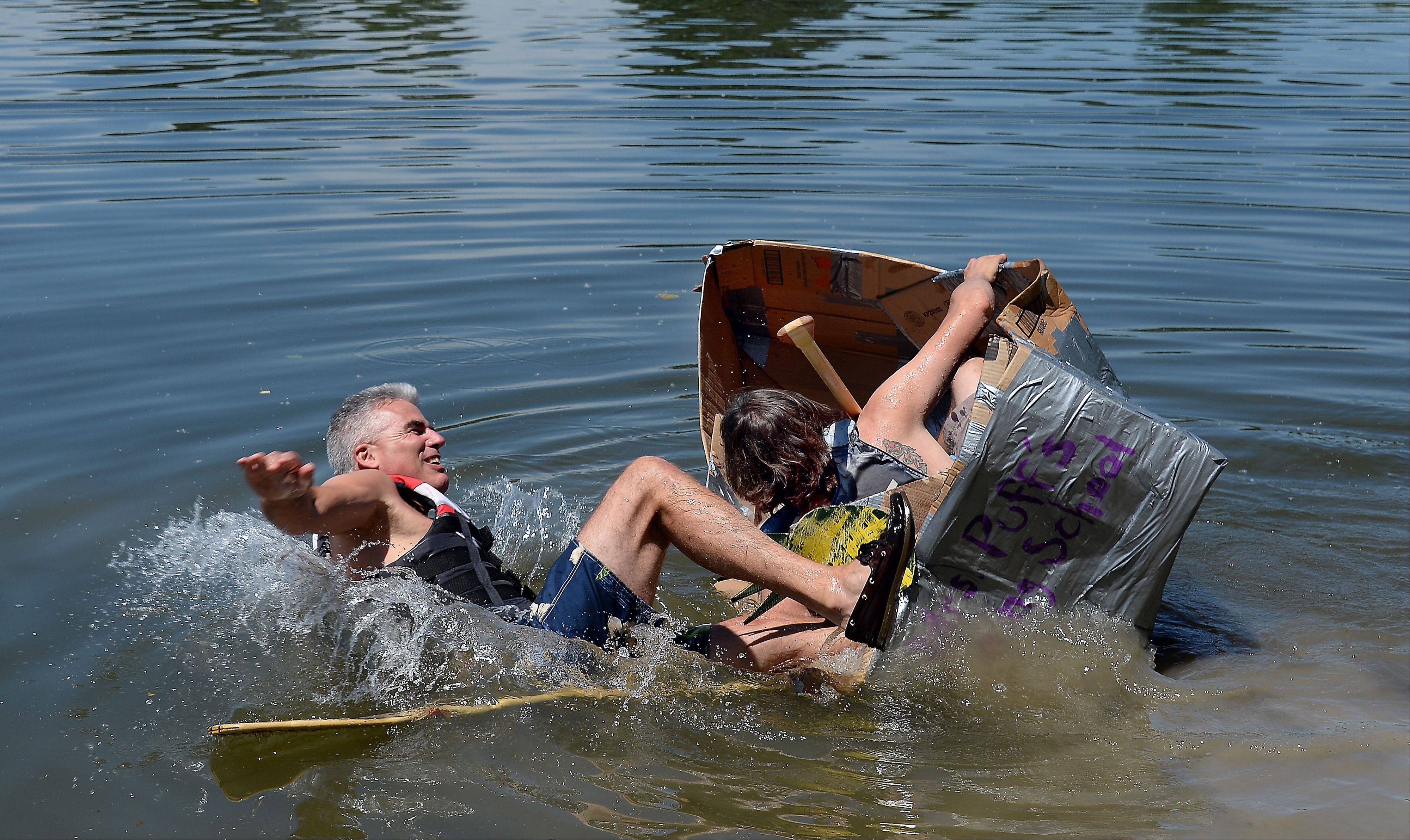 Lasting only 30 seconds before their boat capsized, Mike Flatley of Lake Villa hits the water, followed in short order by his son, Patrick Flatley of Antioch.