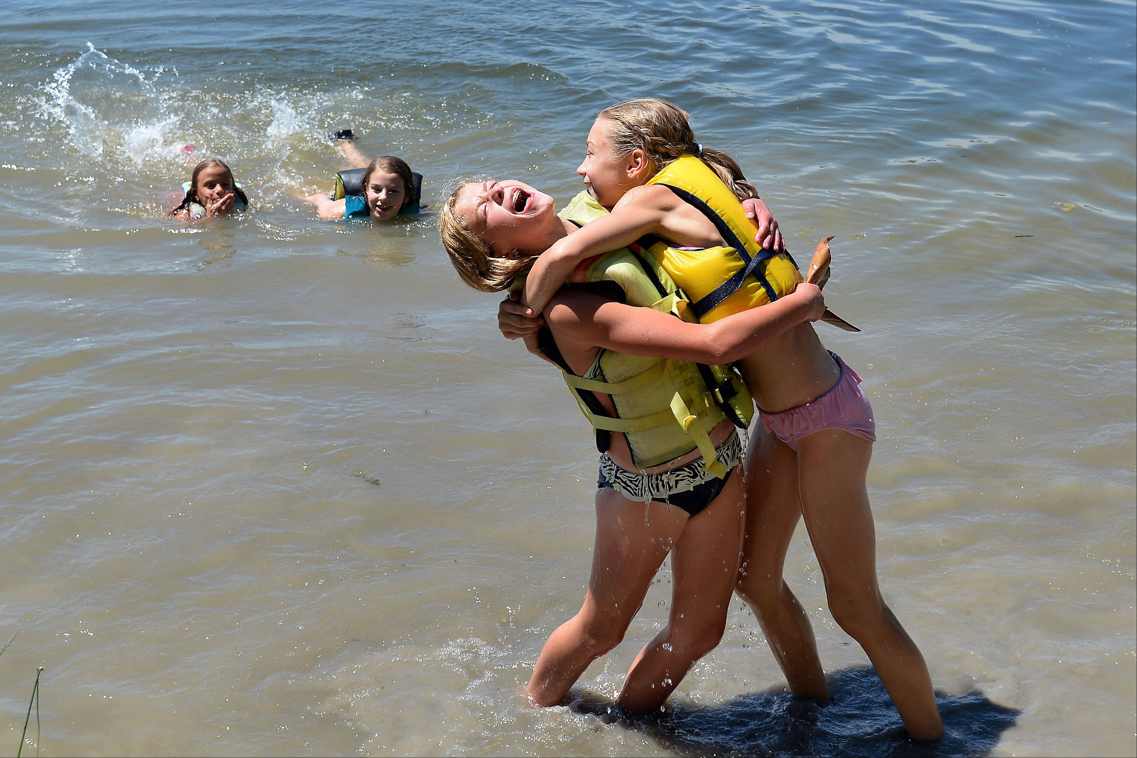 "Aliya Rhodes, 11, left, and Jessica Lamberty, 13, celebrate the ""4 Majestic Mermaids'"" win."