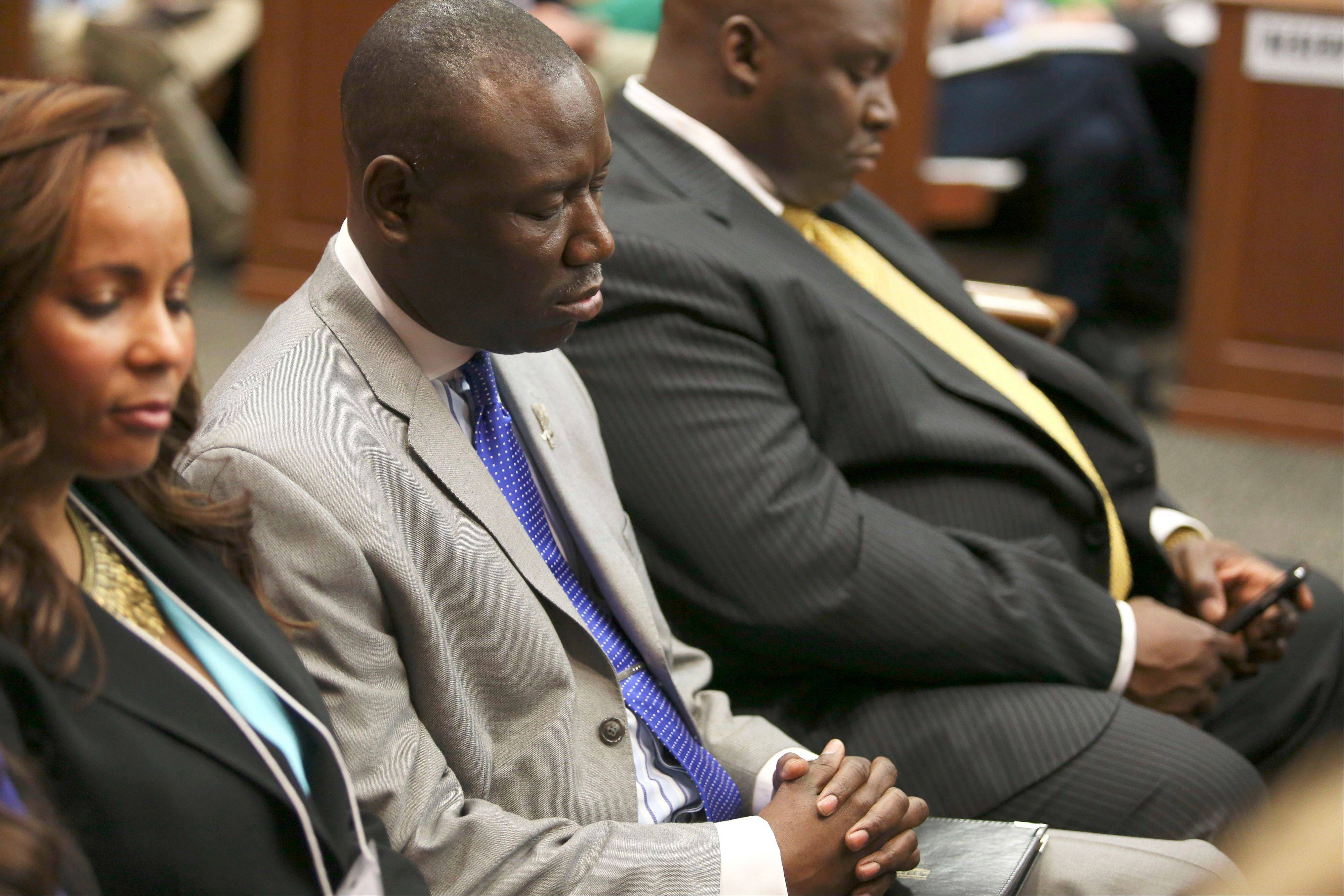 Attorneys Natalie Jackson, Benjamin Crump, and Daryl Parks, from left, sit in for the Trayvon Martin family during George Zimmerman's trial in Seminole circuit court in Sanford, Fla. on Saturday, July 13, 2013. Jurors found Zimmerman not guilty of second-degree murder in the fatal shooting of 17-year-old Martin in Sanford, Fla. The six-member, all-woman jury deliberated for more than 15 hours over two days before reaching their decision Saturday night.