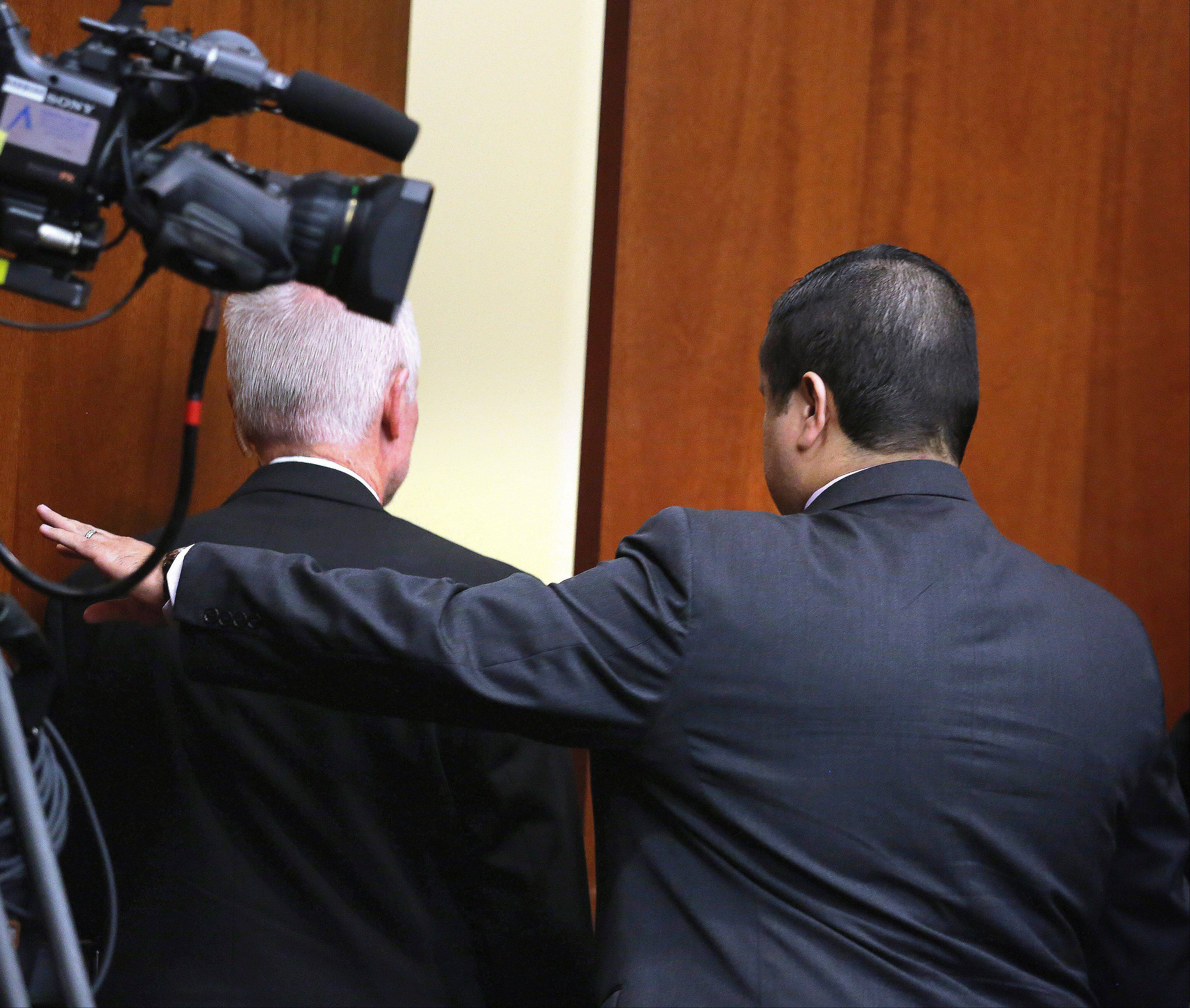 George Zimmerman, right, leaves court after Zimmerman's not guilty verdict was read in Seminole Circuit Court in Sanford, Fla. on Saturday, July 13, 2013. Jurors found Zimmerman not guilty of second-degree murder in the fatal shooting of 17-year-old Trayvon Martin in Sanford, Fla.