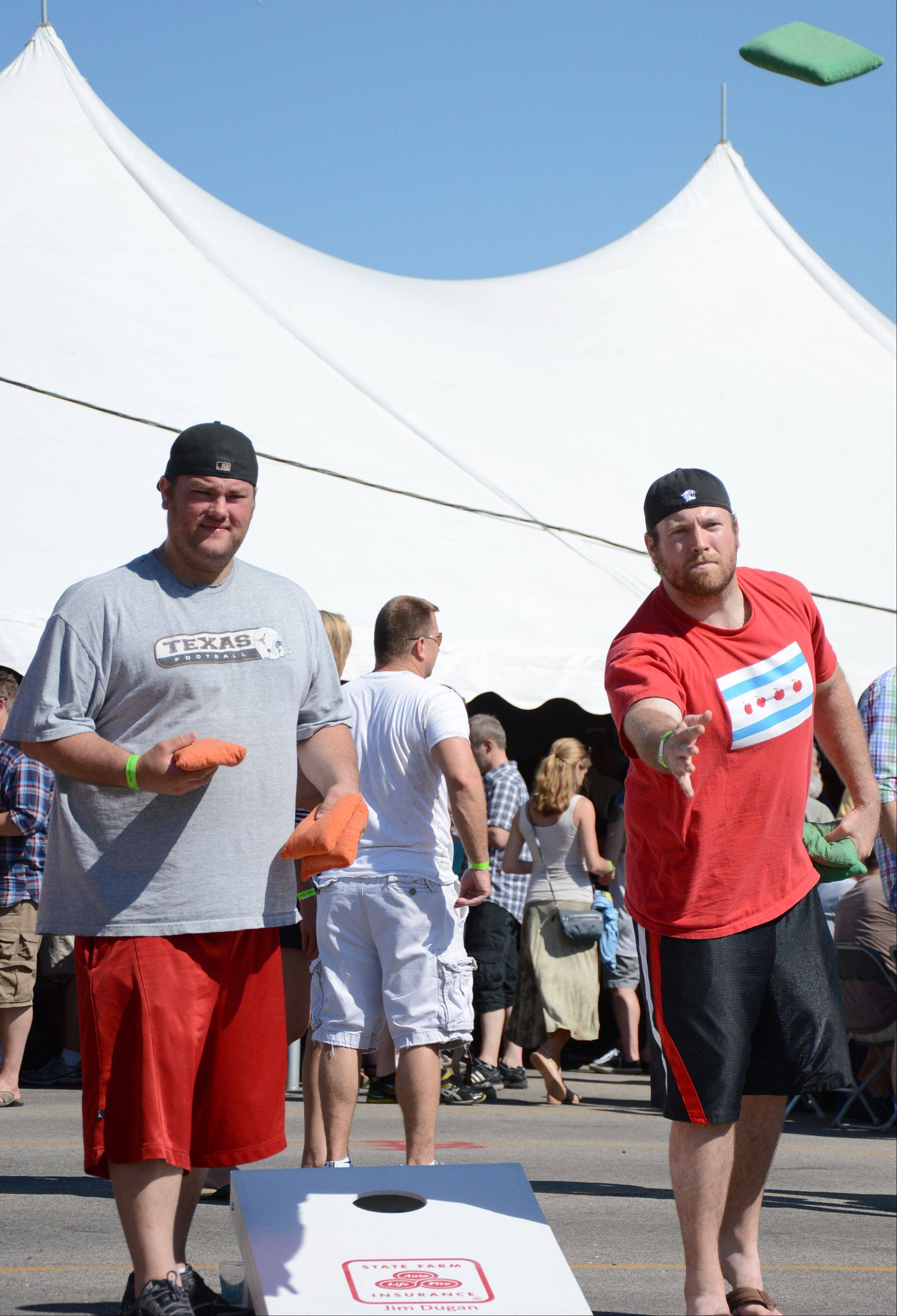 Mark Barkulis, left, and Sean Ryder, both of Chicago, play bags at the Barrington Brew Fest on Saturday.