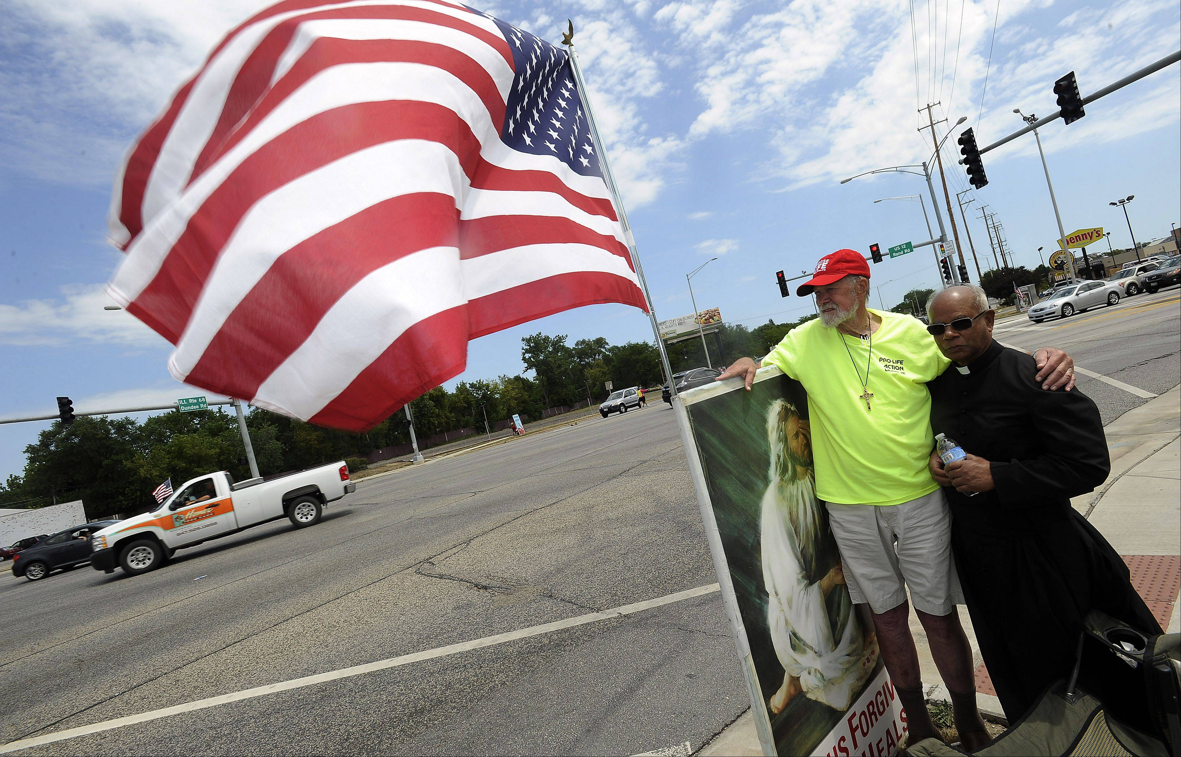 Abortion opponents Joe Scheidler of Chicago and Rev. Neville Monteiro of Lake Zurich stand at the intersection of Dundee and Rand roads in Palatine spreading their message. Lake Zurich police say they are ready for the return of the Pro-Life Action League's Face the Truth tour Thursday morning. The tour also will stop in Palatine and Arlington Heights.