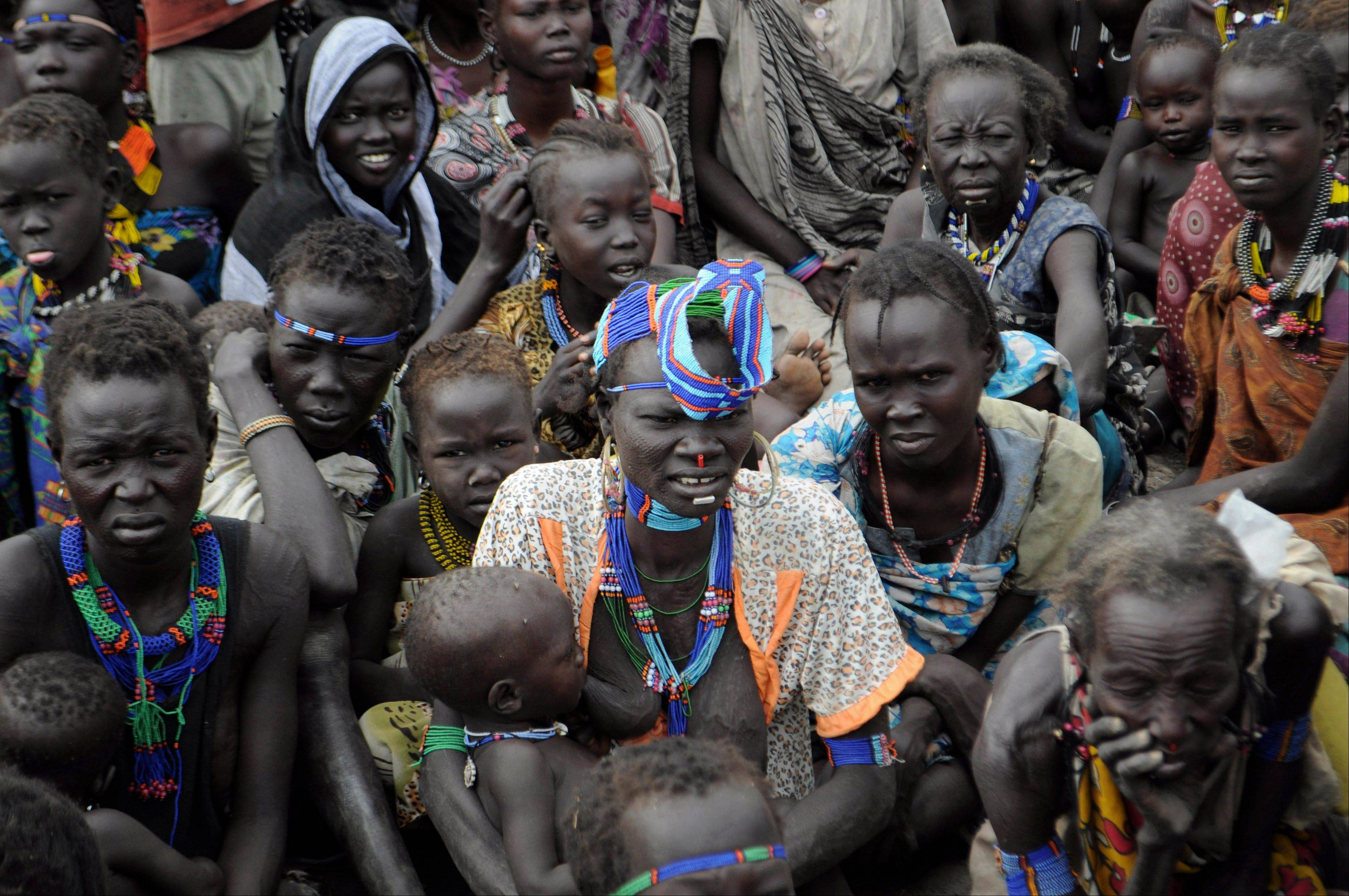Victims of ethnic violence in Jonglei, state, South Sudan, wait in line at the World Food Program distribution center in Pibor to receive emergency food rations.