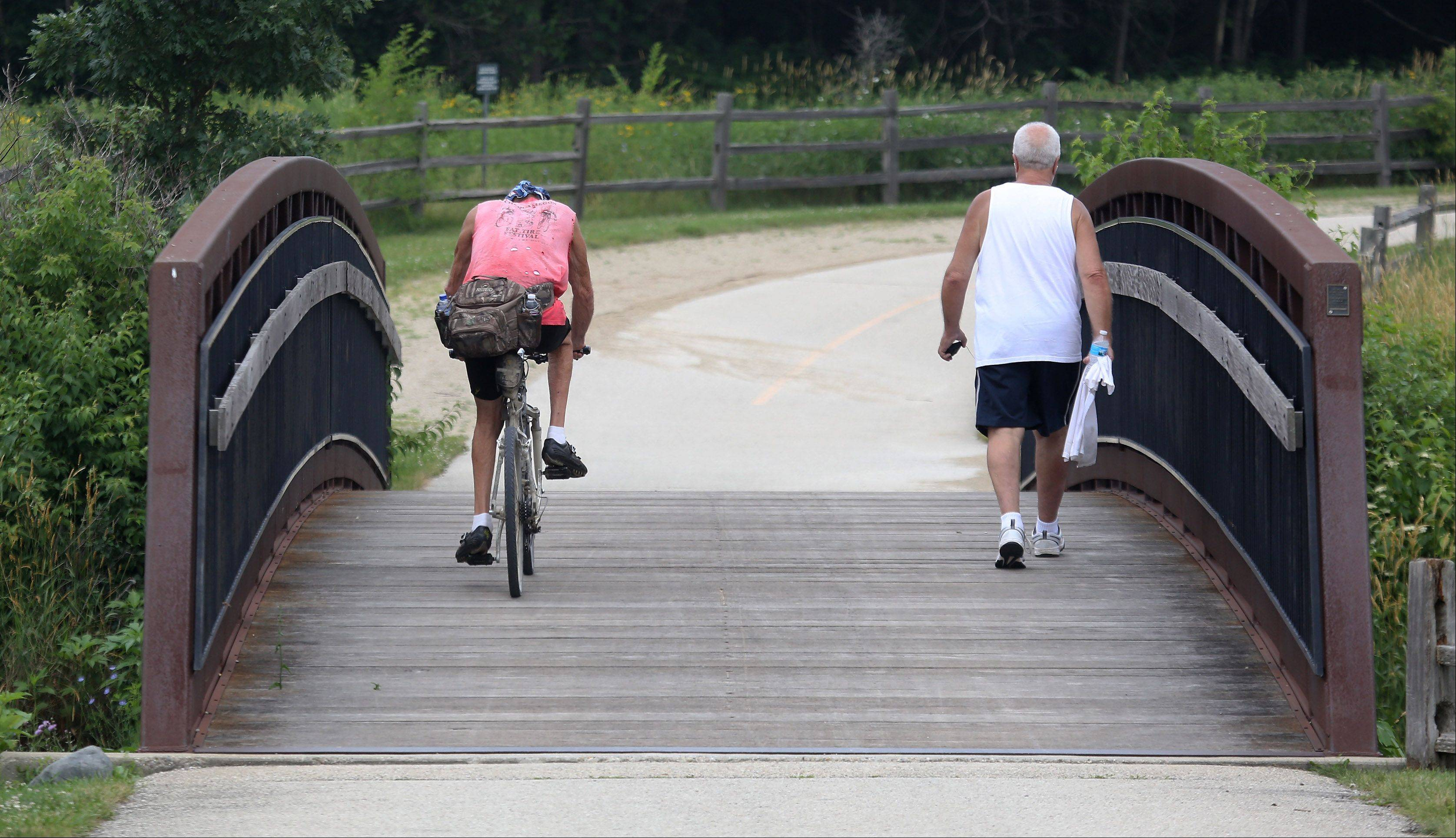 Bicyclists and walkers share the paths Tuesday in Independence Grove Forest Preserve near Libertyville.