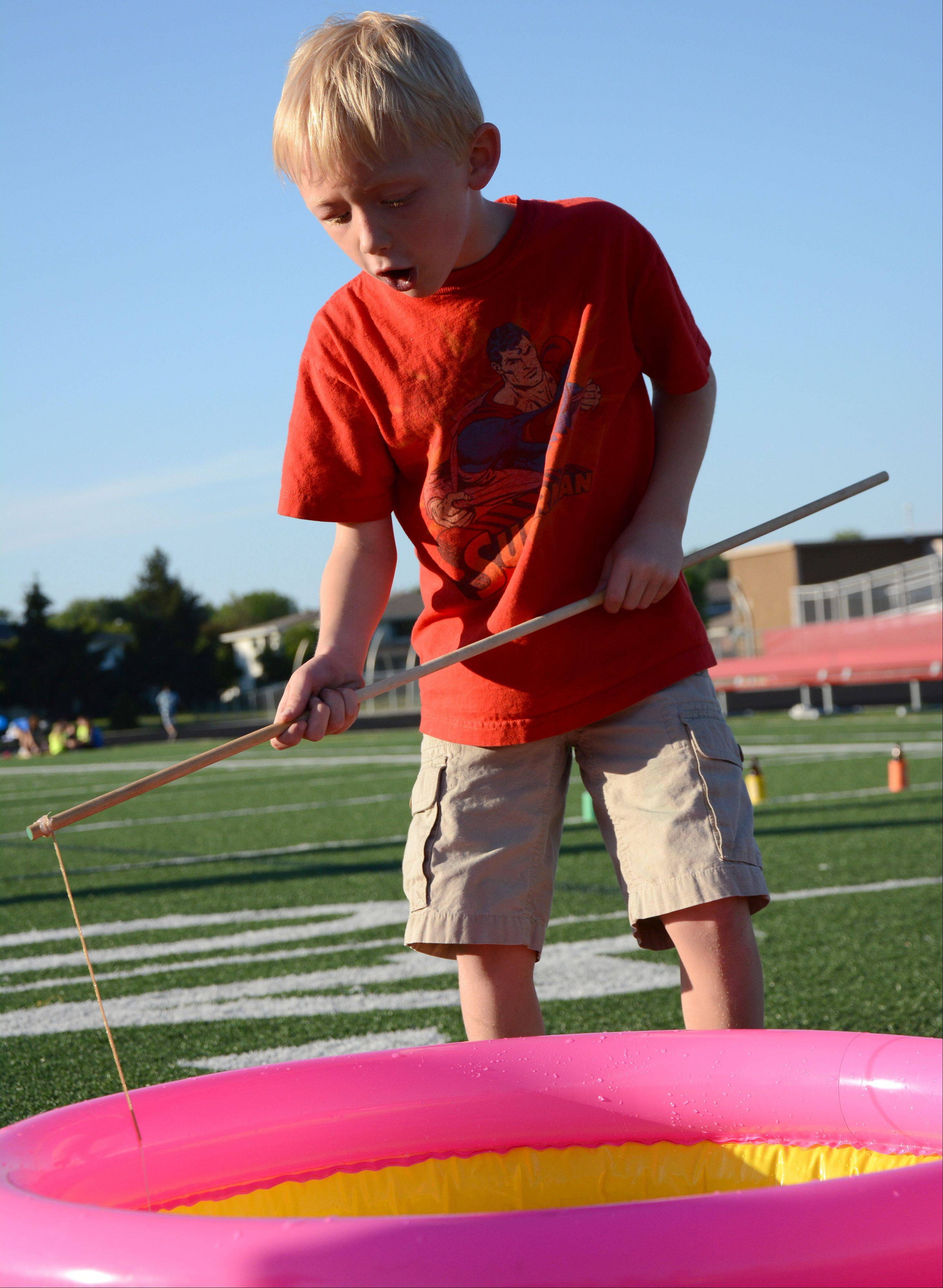 Jack Wienke, 7, of Hoffman Estates attempts to catch a rubber duck Friday. during an event to benefit the Mikias Tefera Tibebu Memorial Scholarship at Schaumburg High School.