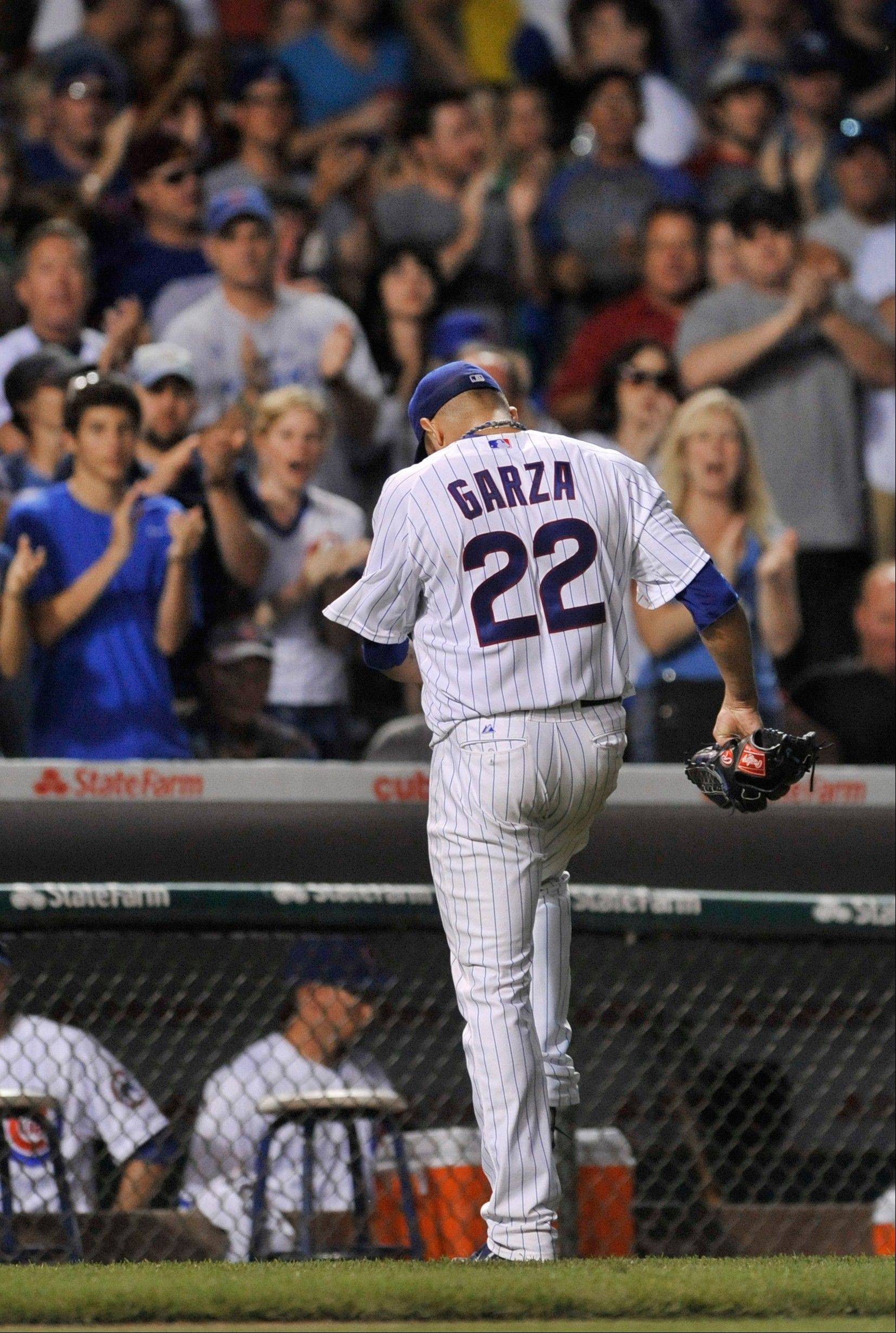 Cubs starter Matt Garza exits the game to cheers with two outs in the seventh inning Saturday at Wrigley Field. While recording his career-best fifth straight win, Garza (6-1) gave up 10 hits and 2 runs. In his last 5 starts, he is 5-0 with a 1.47 earned run average.