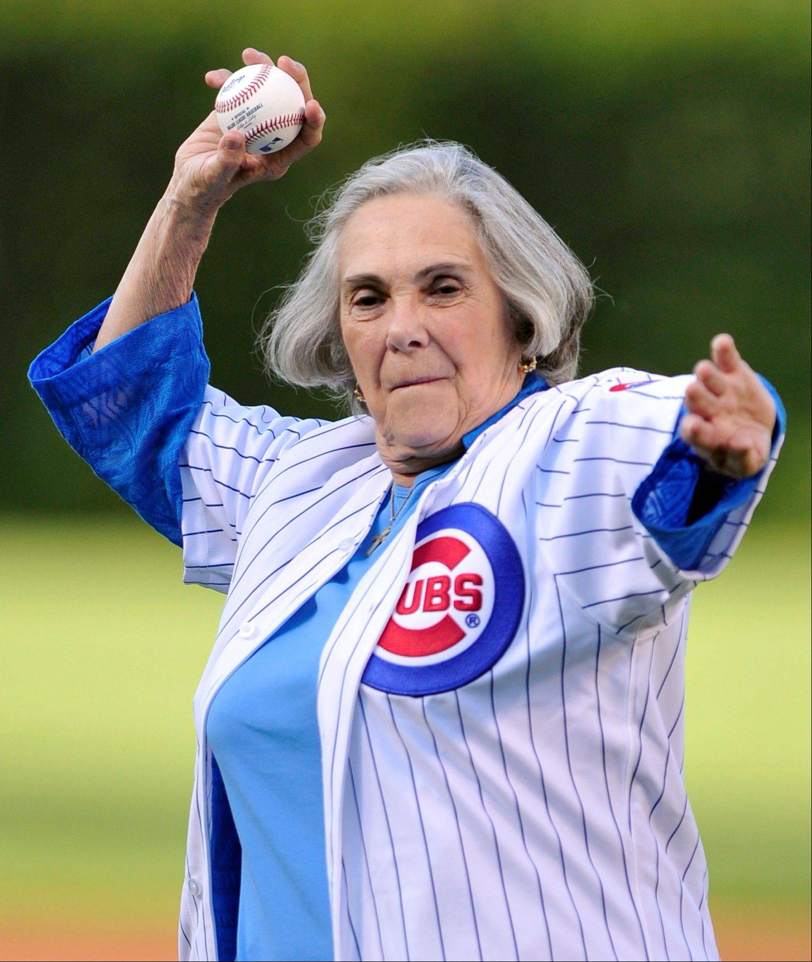 Dutchie Caray, widow of Cubs broadcaster Harry Caray, throws out a ceremonial first pitch before a baseball game between the St. Louis Cardinals and the Chicago Cubs in Chicago, Saturday, July 13, 2013.