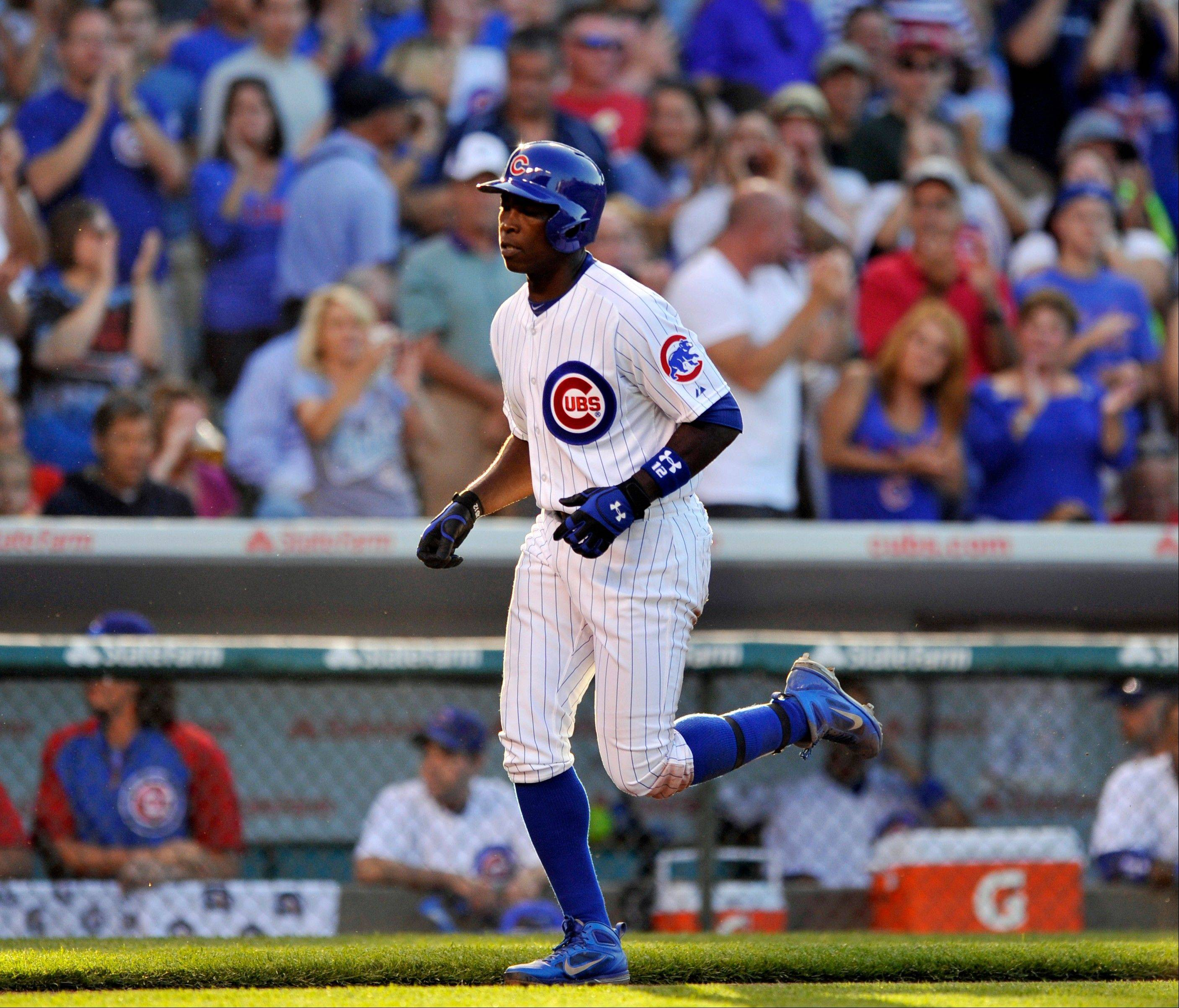 The Cubs' Alfonso Soriano rounds the bases after hitting a solo home run during the third inning of Saturday's game. The Cubs beat the St. Louis Cardinals 6-4 at Wrigley Field.