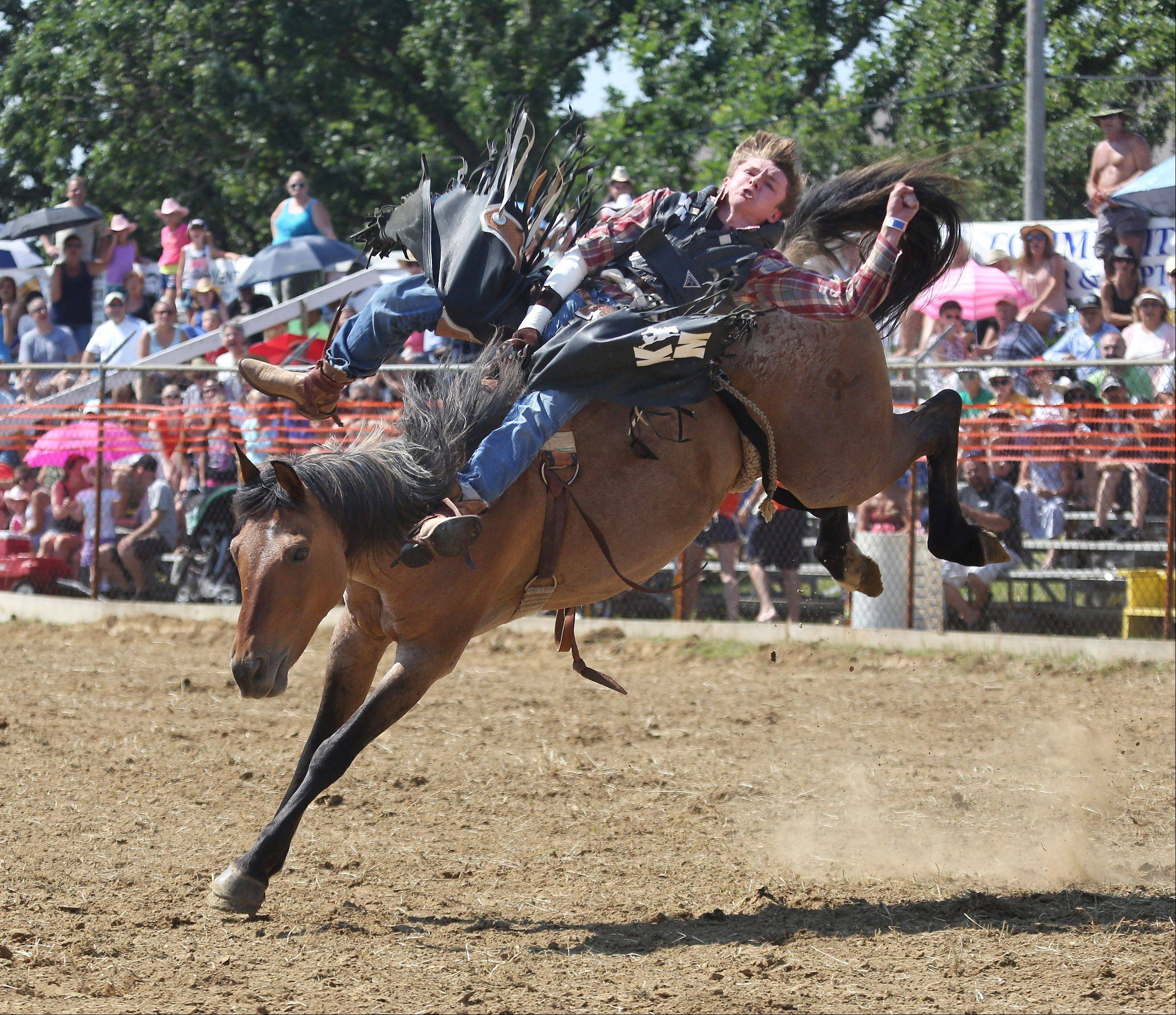 Mark Kreder, Jr. rides a bareback bronc during the 50th Annual IPRA Championship Wauconda Rodeo Sunday at Green Oaks Rodeo Grounds. The Wauconda Area Chamber of Commerce sponsored the event that featured a mechanical bull, pony rides and calf roping as well as the rodeo show.