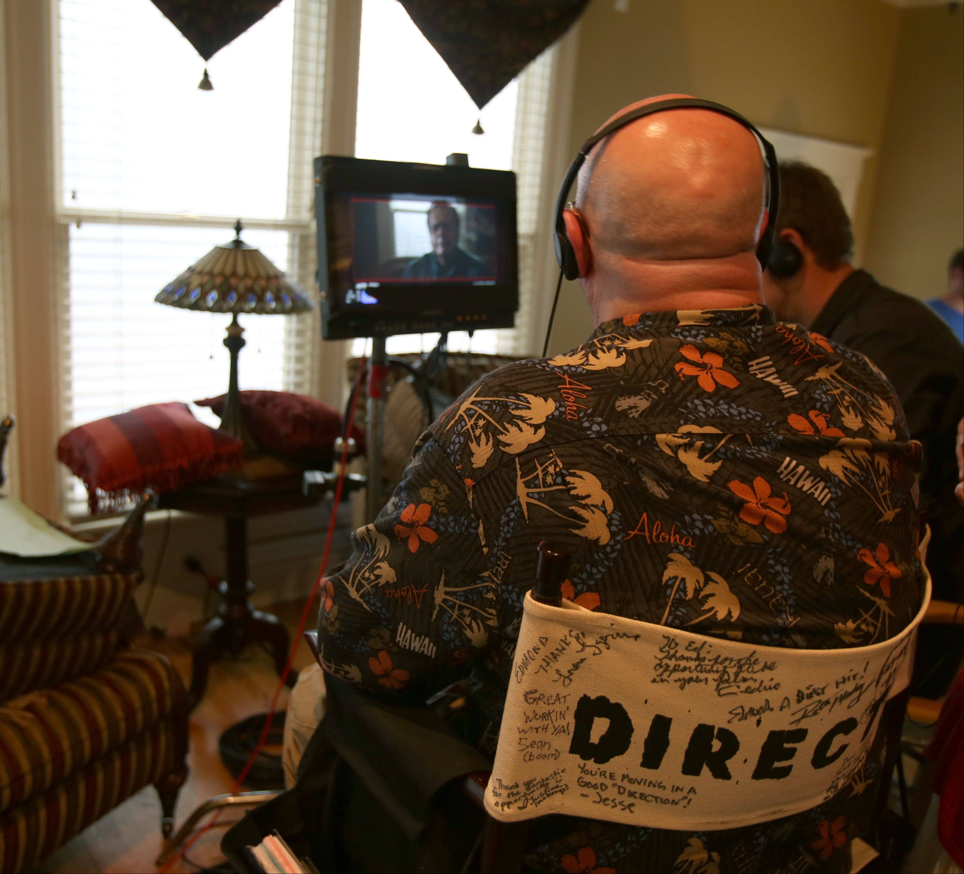 "Director Edmond Coisson monitors filming of the movie ""Precious Mettle"" at a home in downtown Naperville last month. Other scenes were shot at a home in Aurora."