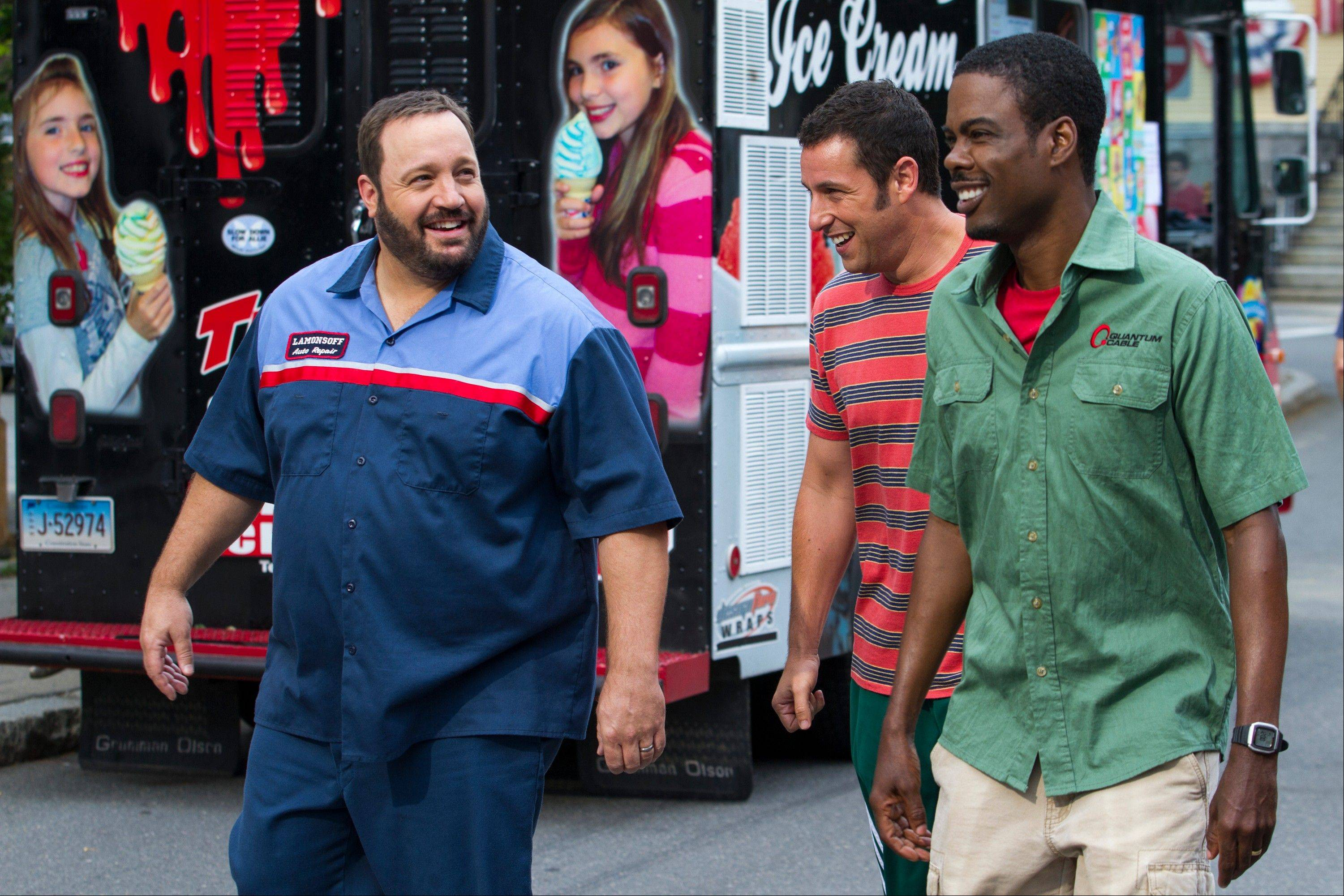 "This film publicity image released by Columbia Pictures shows, from left, Kevin James, Adam Sandler and Chris Rock in a scene from ""Grown Ups 2."""