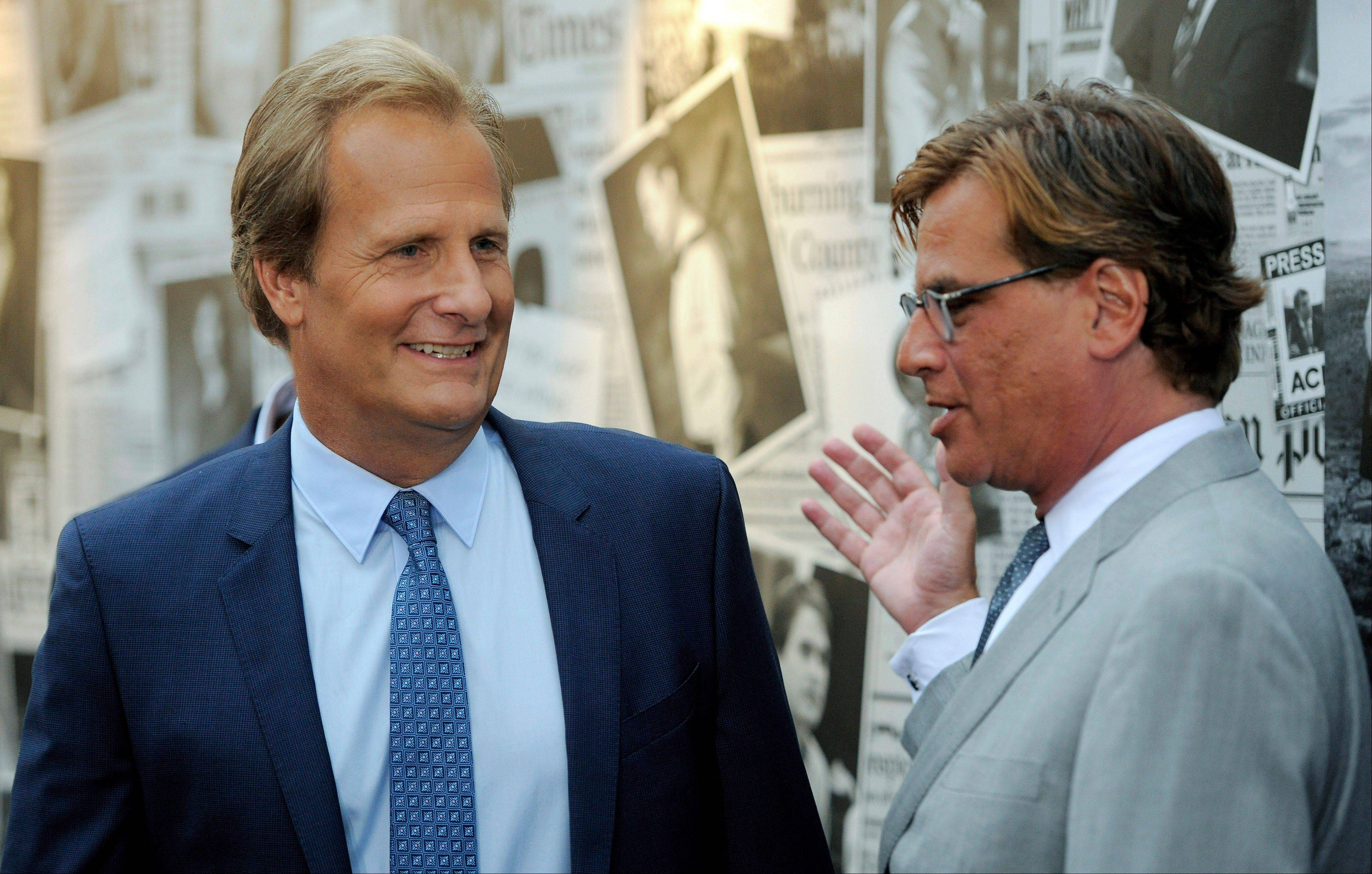 "Aaron Sorkin, right, creator/executive producer of ""The Newsroom,"" greets cast member Jeff Daniels at the season 2 premiere of the HBO series at the Paramount Theater on Wednesday in Los Angeles."