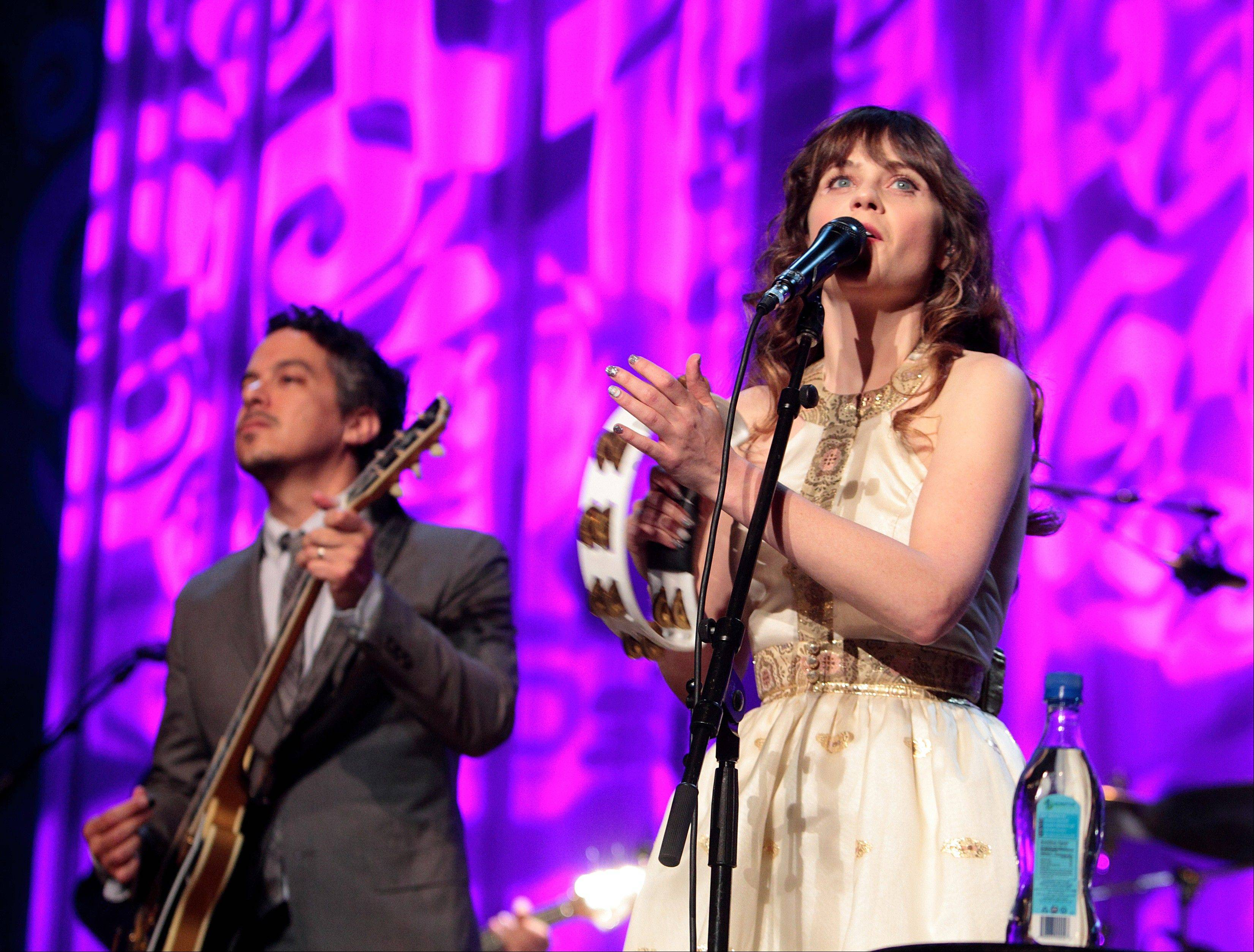 Indie rock band She & Him with Zooey Deschanel and M. Ward performs at the Mann Center in Philadelphia.