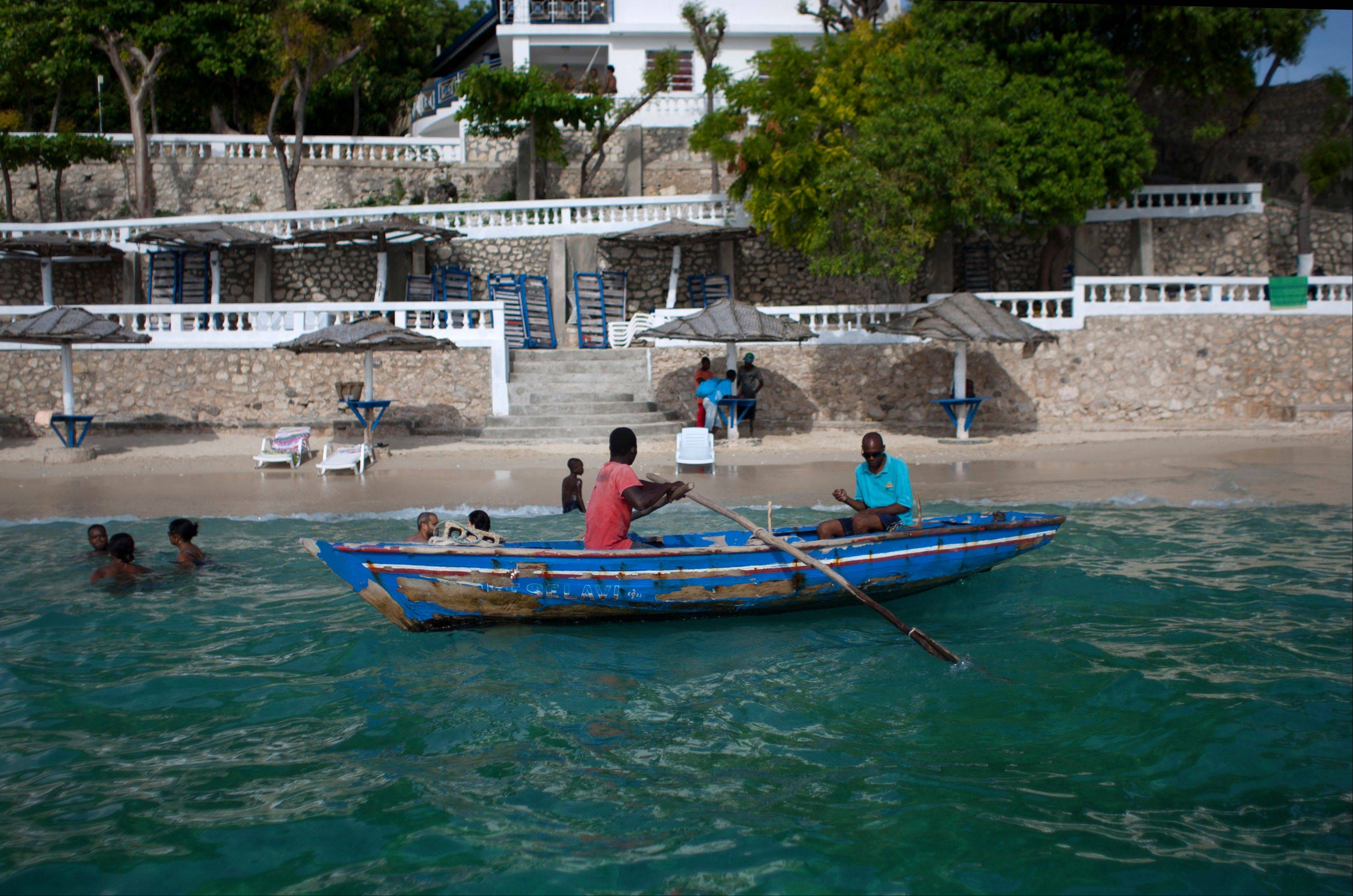 A water taxi waits for customers at the Wahoo Bay Beach hotel in Montrouis, Haiti.