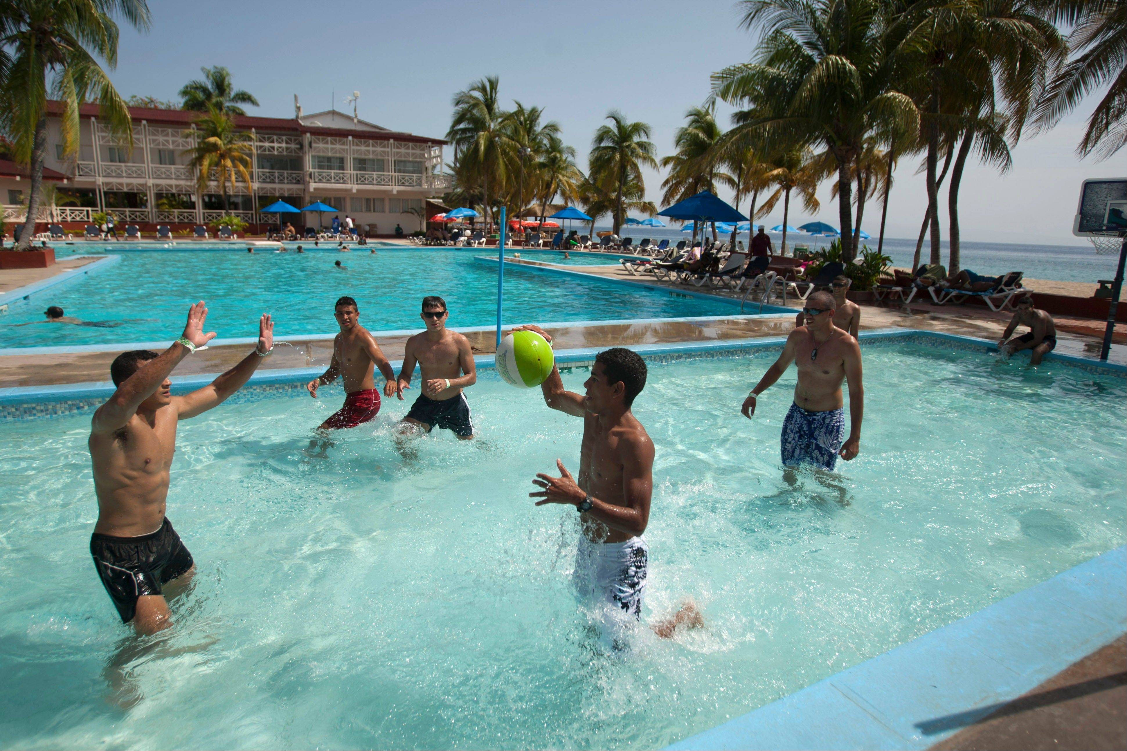 Tourists play pool basketball at Club Indigo beach resort in Montrouis, Haiti. The Haitian government is trying to revive the country's long stagnant tourism industry.