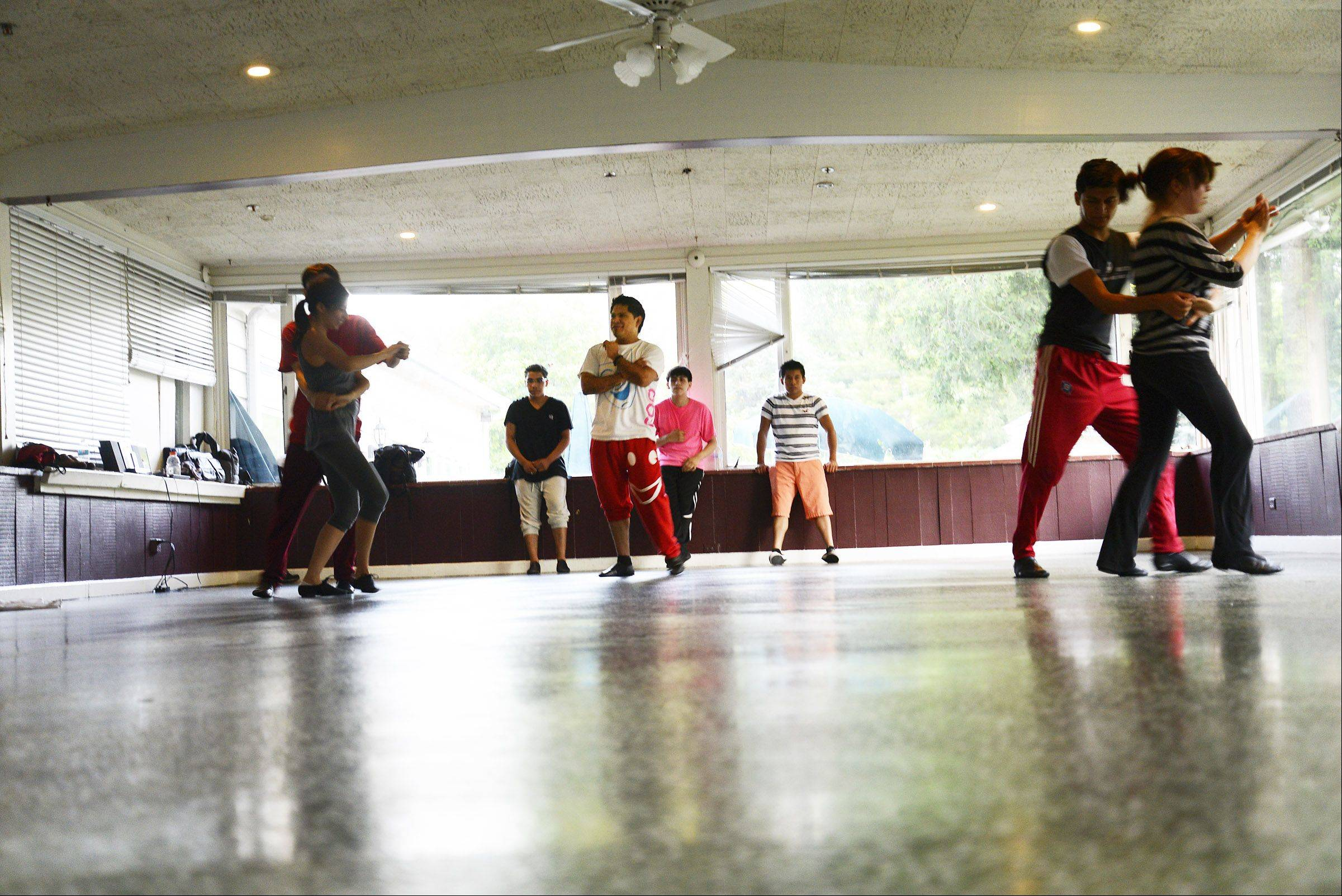 Ivan Moctezuma watches some of his 25 student dancers rehearse in his temporary studio in the Milk Pail banquet hall on Route 25 in East Dundee. Ivan and his brother Angel own and operate Ivangel Dance Studio Inc. and are try to get approval from the City of Elgin to move the business there.