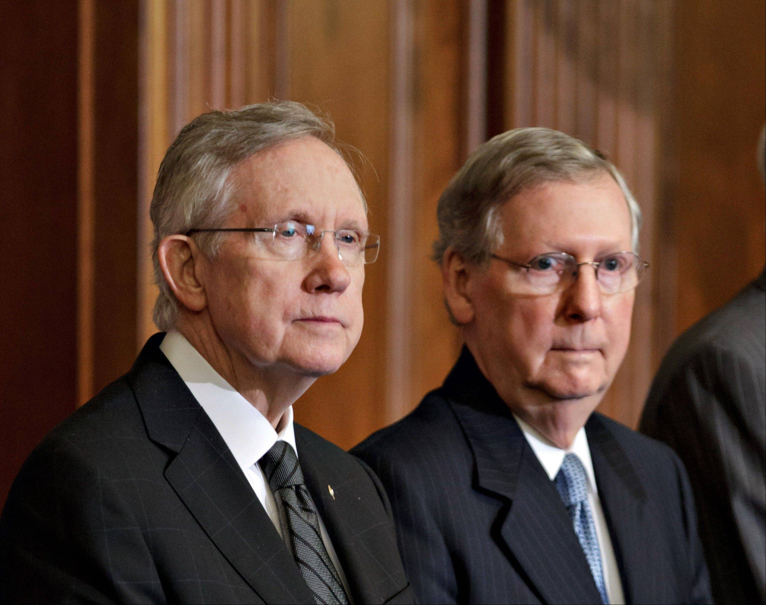 Senate Majority Leader, Democrat Harry Reid of Nevada, and Senate Minority Leader, Republican Mitch McConnell of Kentucky, right, sparred Sunday on a morning news program. Today the Senate holds a rare closed-door session, where all senators will consider a proposal to change Senate rules to remove a 60-vote threshold for President Barack Obama's nominations to win confirmation.