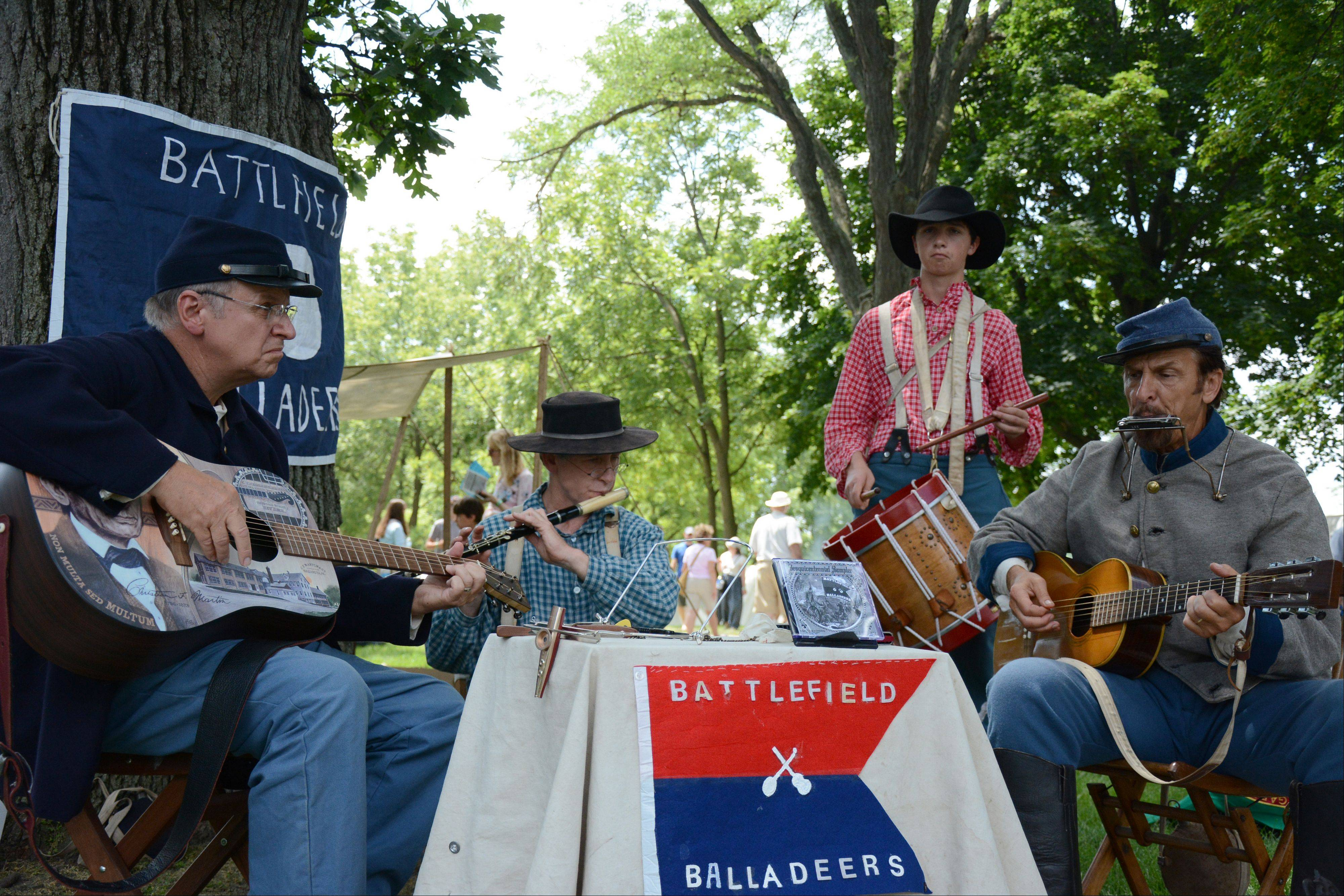 From left to right, Jim Schranz, of Lindenhurst, Steve Smunt, of St. Charles, Mike Novak, of Crystal Lake, and Dave Corbett, of Buffalo Grove, play period music Sunday during Civil War Days at the Lakewood Forest Preserve near Wauconda.