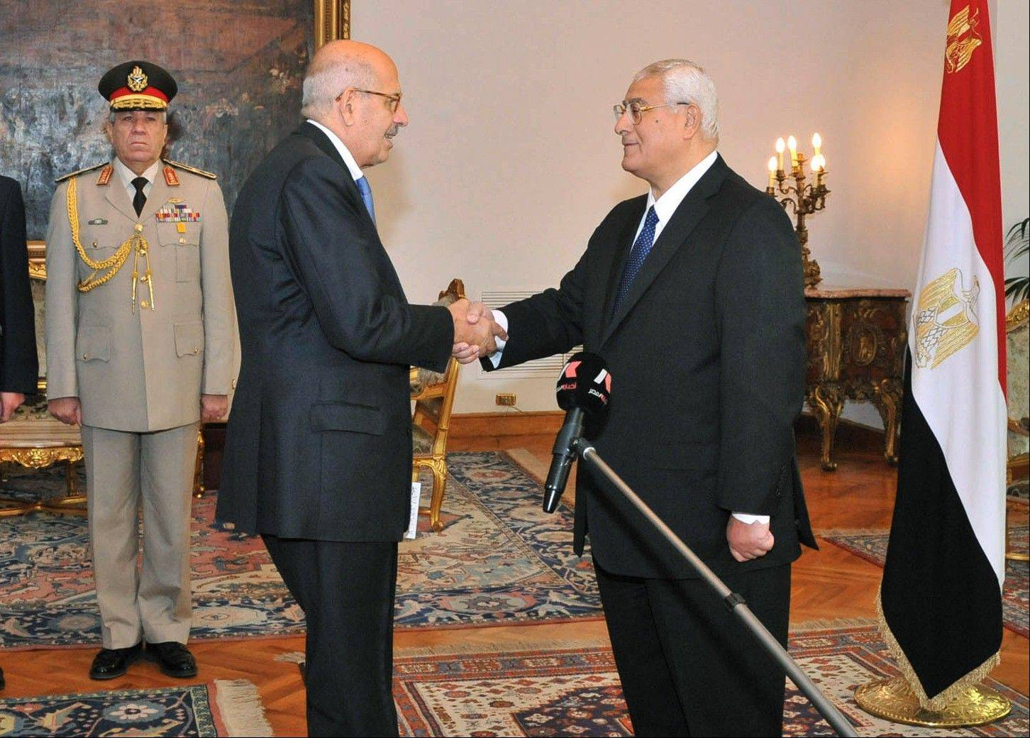Pro-democracy leader Mohamed ElBaradei, a leader of the National Salvation Front, center left, shakes hands with interim President Adly Mansour after being sworn in as vice president in Cairo on Sunday.