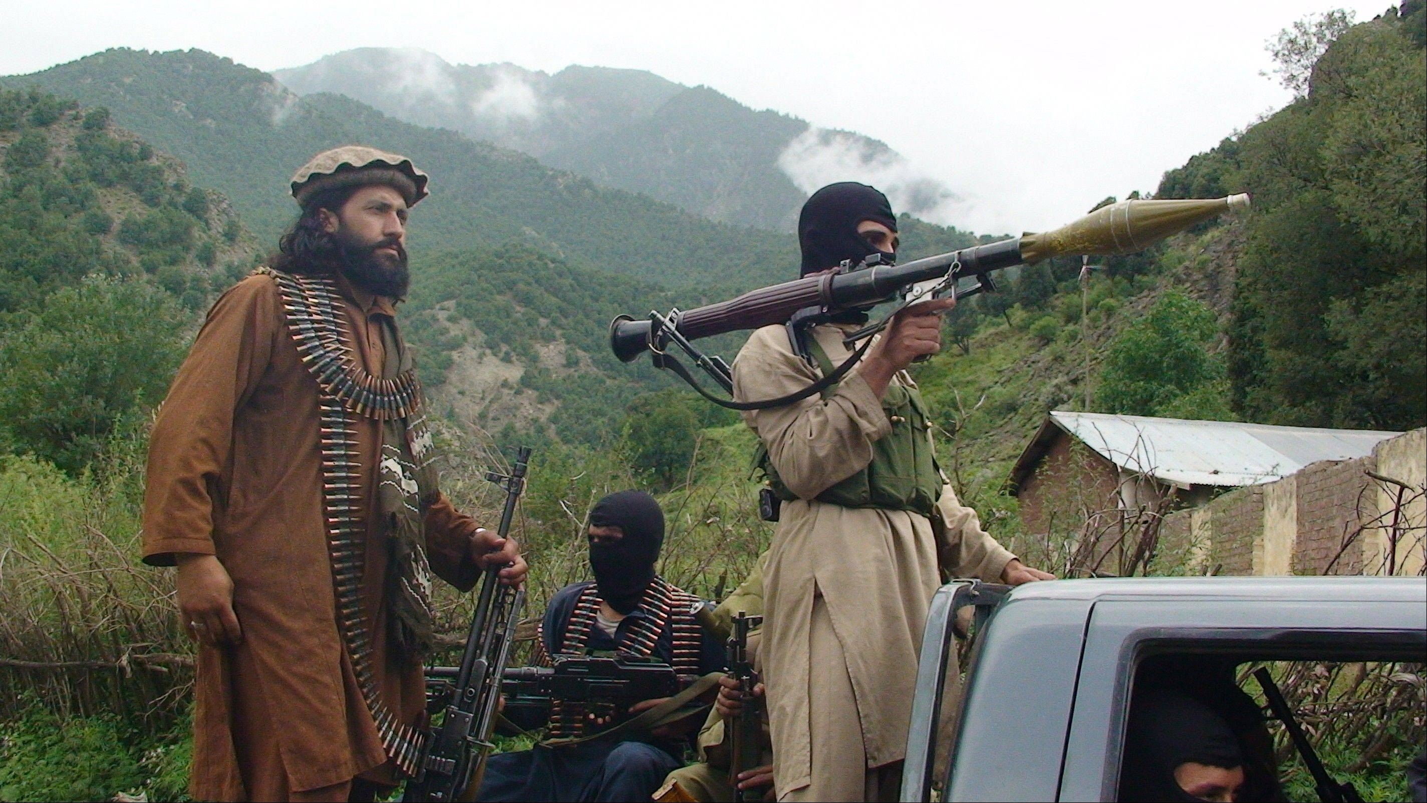Pakistani Taliban patrol in their stronghold of Shawal in Pakistani tribal region of South Waziristan on Aug. 5, 2012. Dozens of domestic and foreign militants have left Pakistan for Syria in recent months.