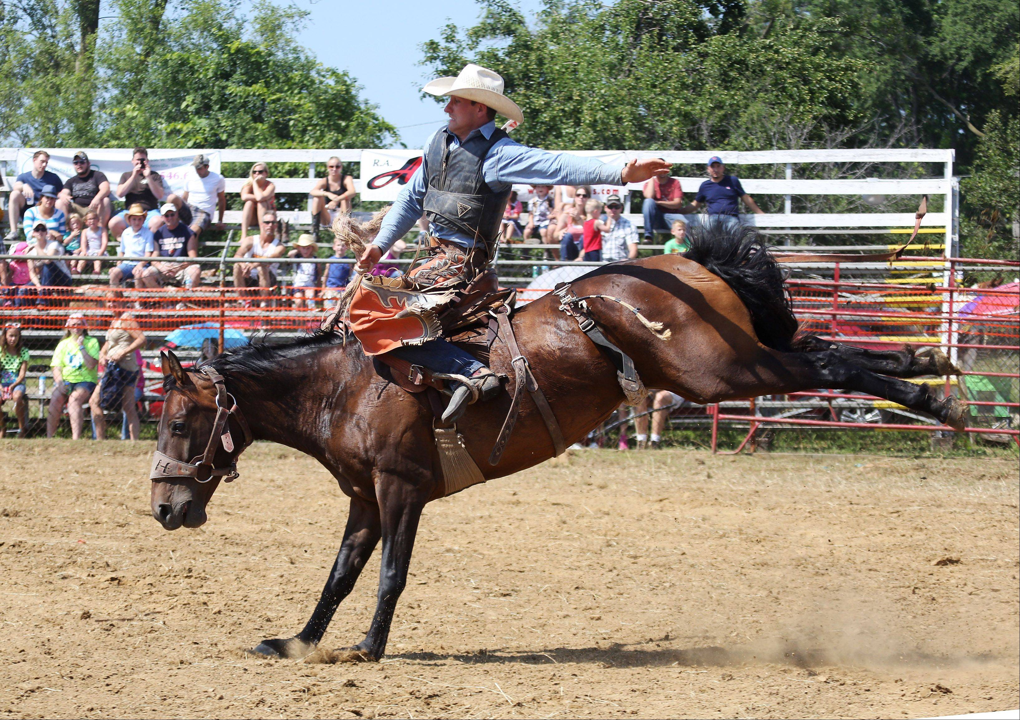 Trace Hughston rides saddleback bronc during the 50th Annual IPRA Championship Wauconda Rodeo Sunday at Green Oaks Rodeo Grounds. The Wauconda Area Chamber of Commerce sponsored the event that featured a mechanical bull, pony rides and calf roping as well as the rodeo show.