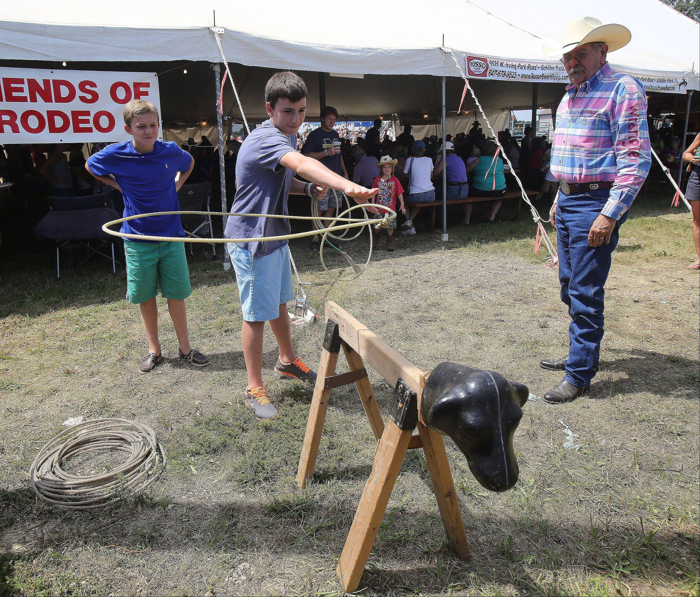 Max Lovitola, 13, of Lake Forest throws a rope around a fake calf during the 50th Annual IPRA Championship Wauconda Rodeo Sunday at Green Oaks Rodeo Grounds. The Wauconda Area Chamber of Commerce sponsored the event that featured a mechanical bull, pony rides and calf roping as well as the rodeo show.