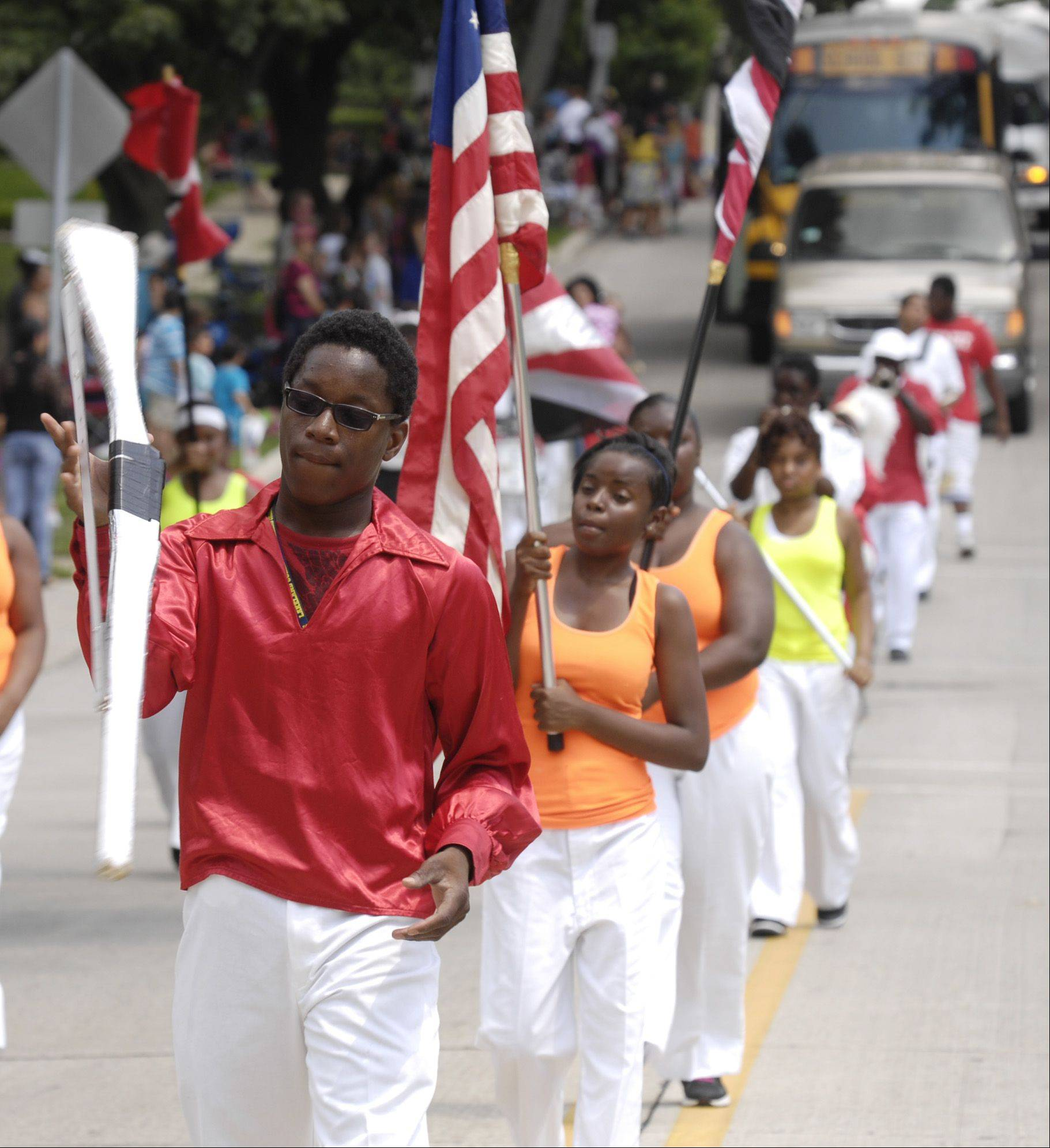 The South West Rifle and Drill Team marches in the West Chicago Railroad days parade, Sunday.
