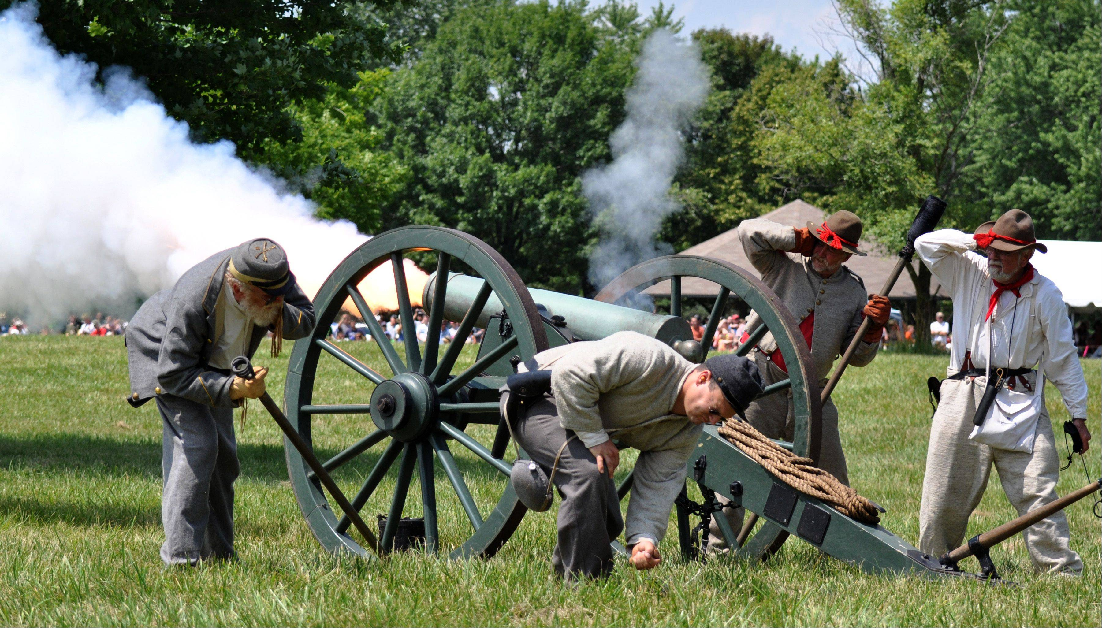 The 9th Virginia Calvary fires a canon during a battle re-enactment at Civil War Days held at the Lakewood Forest Preserve Sunday, July 14.