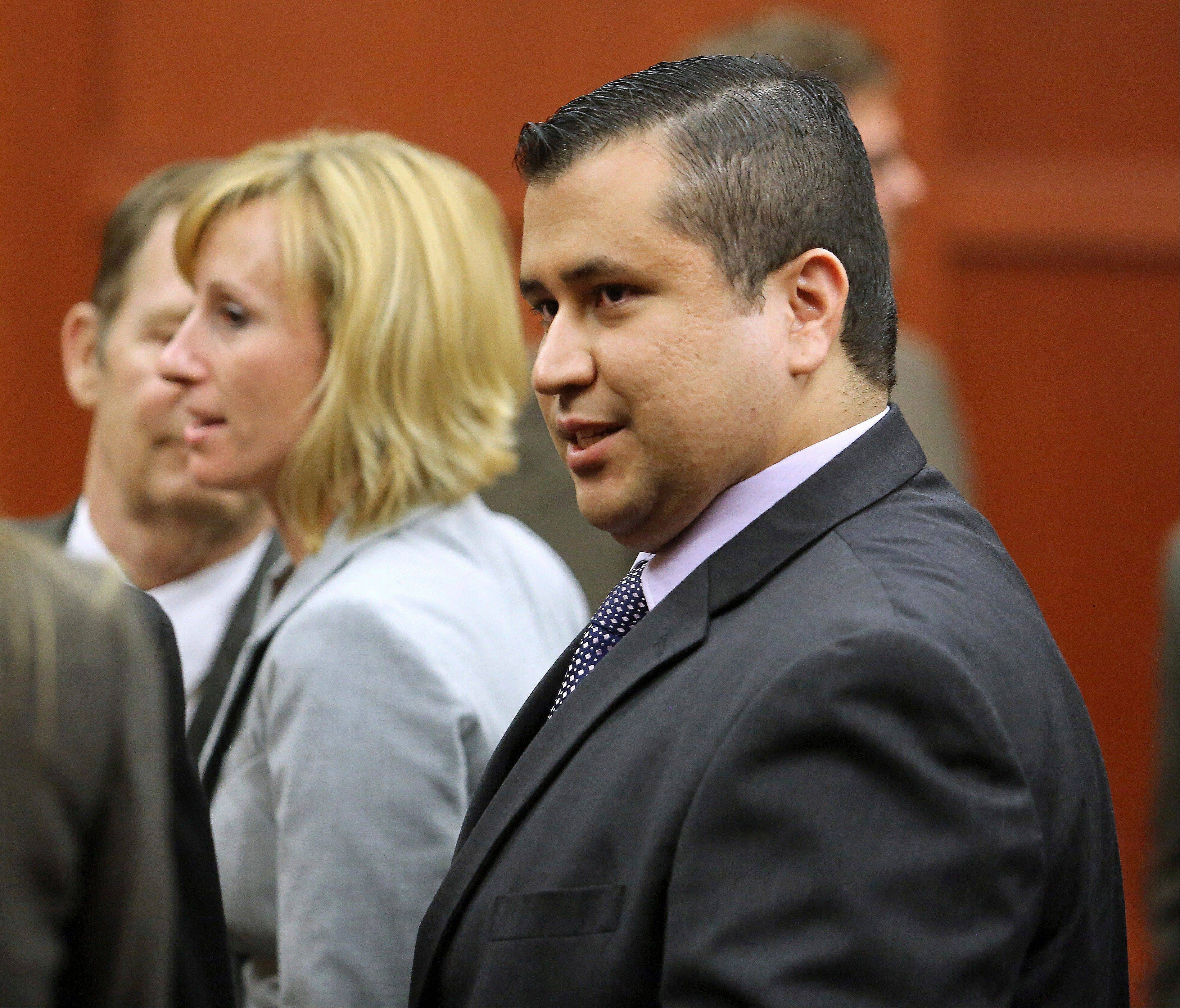George Zimmerman leaves court with his family after Zimmerman's not guilty verdict was read in Seminole Circuit Court in Sanford, Fla., Saturday.