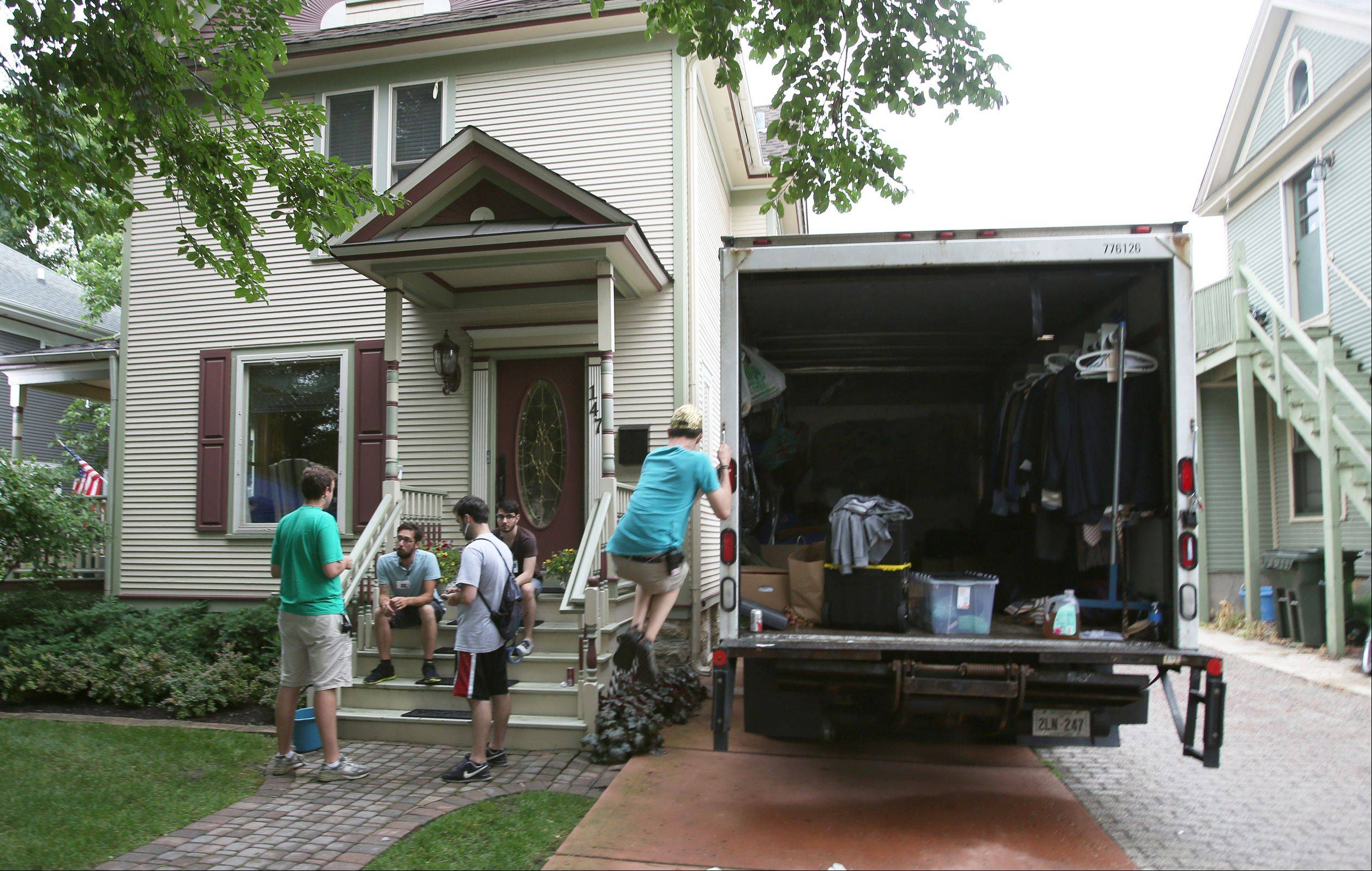 "A crew unloads equipment at a home in downtown Naperville before filming scenes from the movie ""Precious Mettle"" on June 21. The crime drama, from Chicago-based Amarok Productions, stars Paul Sorvino, Fiona Dourif, Todd Bridges and Joe Estevez. It will be released in 2014."