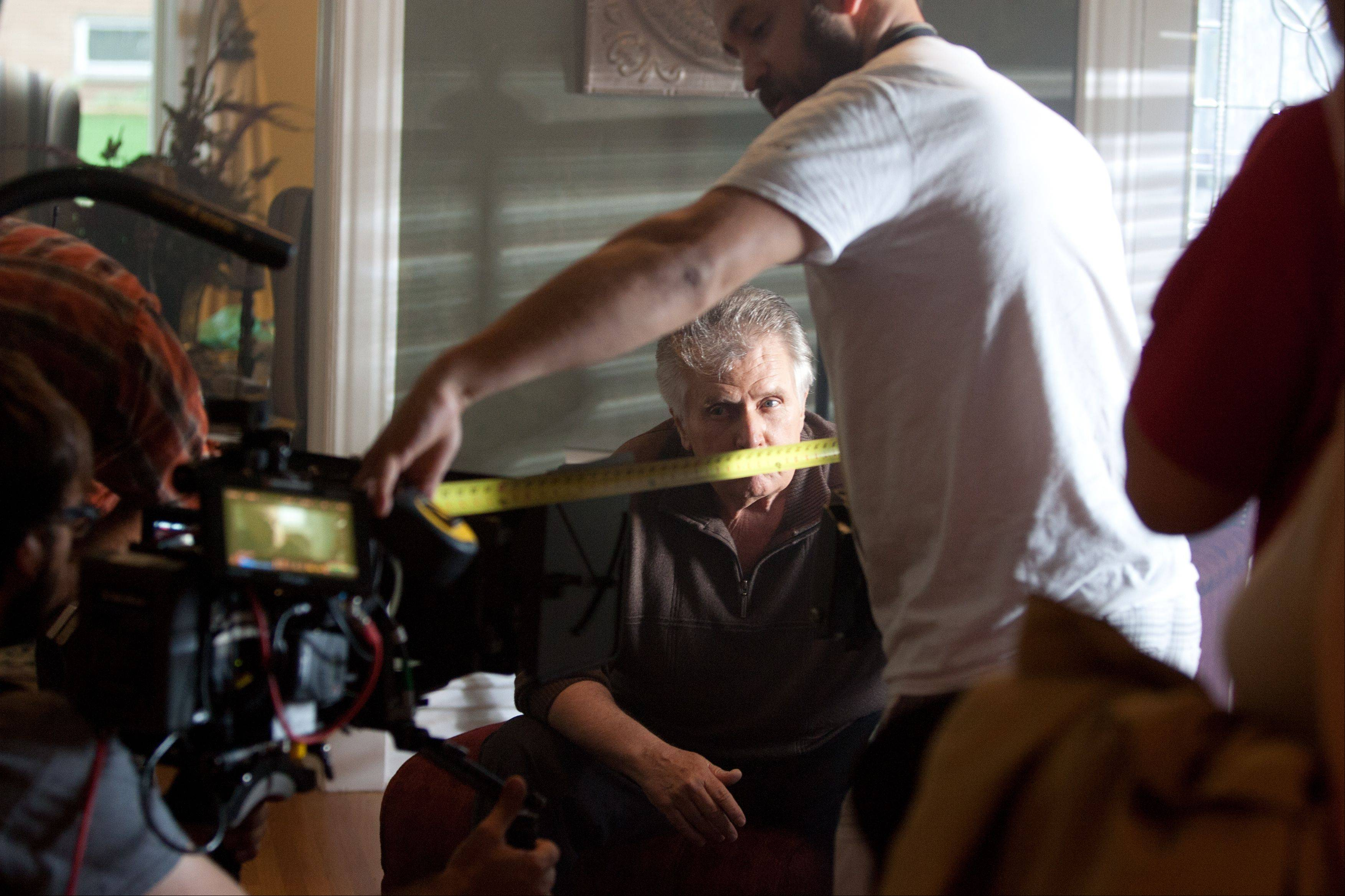 "Focus is checked before actor Joe Estevez reads his lines during filming of the movie ""Precious Mettle"" at a home in downtown Naperville June 21."