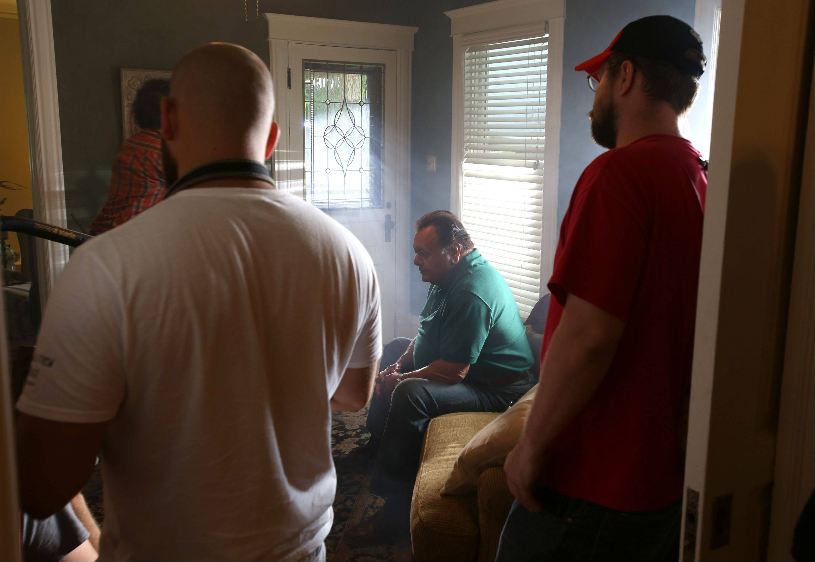 "Actor Paul Sorvino relaxes during filming of the movie ""Precious Mettle"" at a home in downtown Naperville June 21."