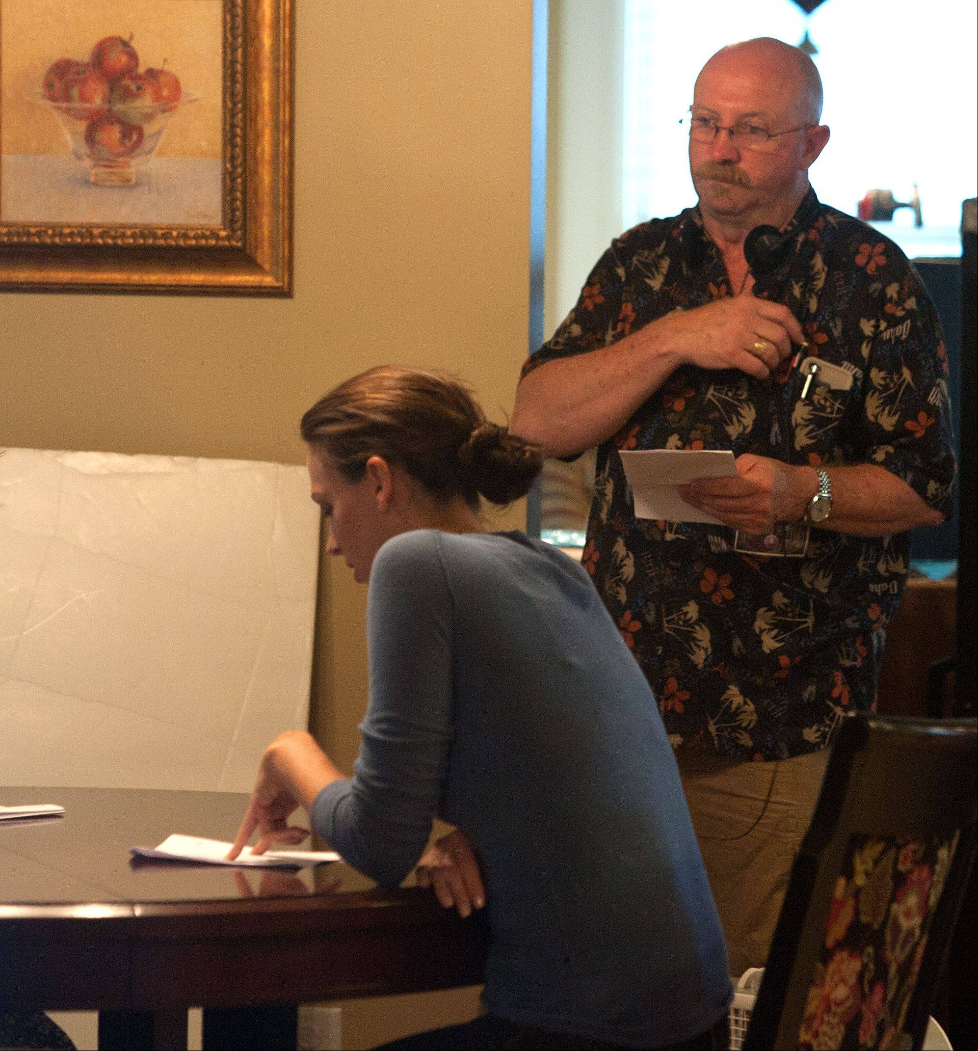"Director Edmond Coisson monitors a short rehearsal session during filming of the movie ""Precious Mettle"" at a home in downtown Naperville last month. Other scenes were shot at a home in Aurora."