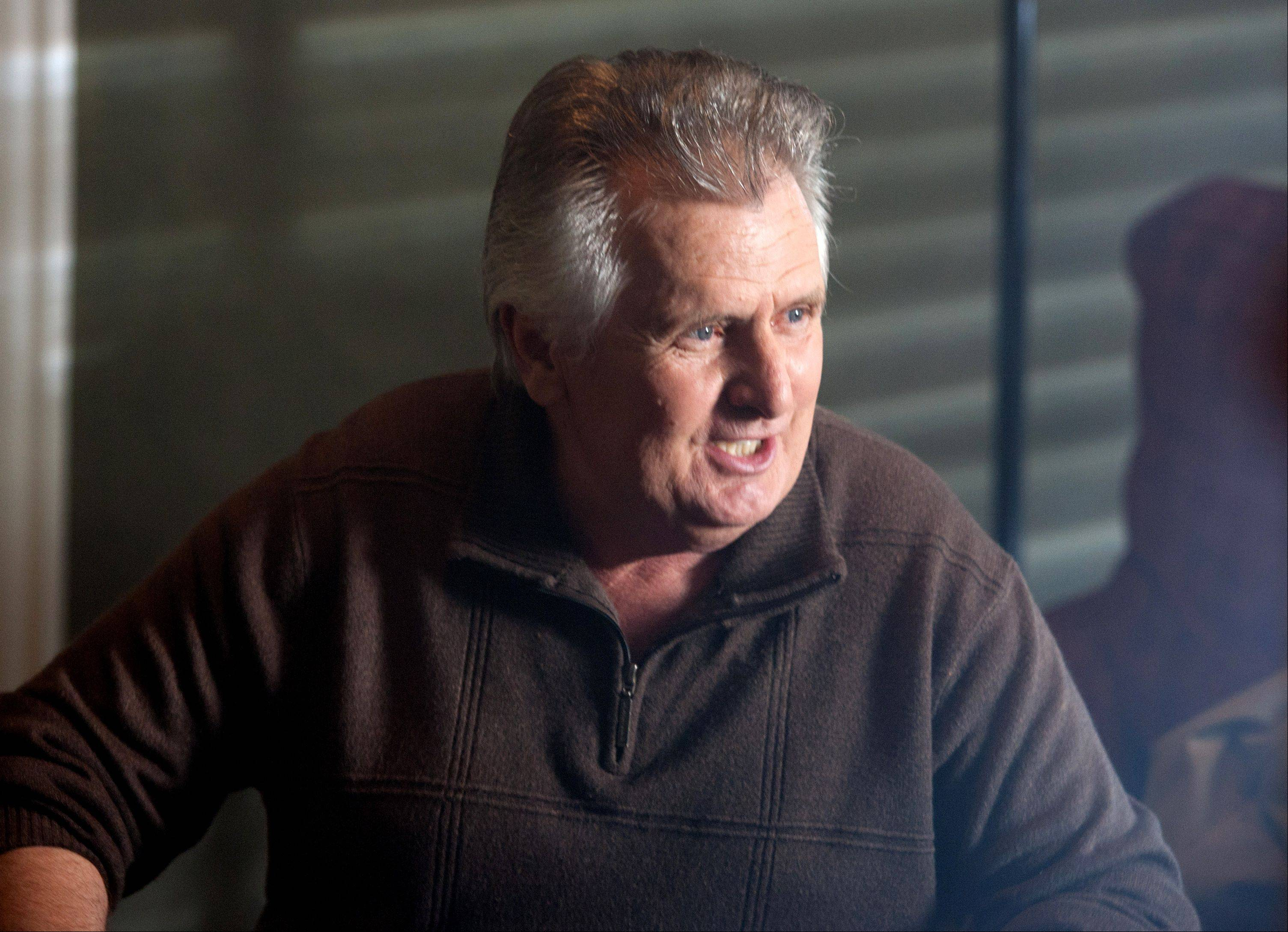 "Actor Joe Estevez relaxes during filming of the movie ""Precious Mettle"" at a home in downtown Naperville June 21."