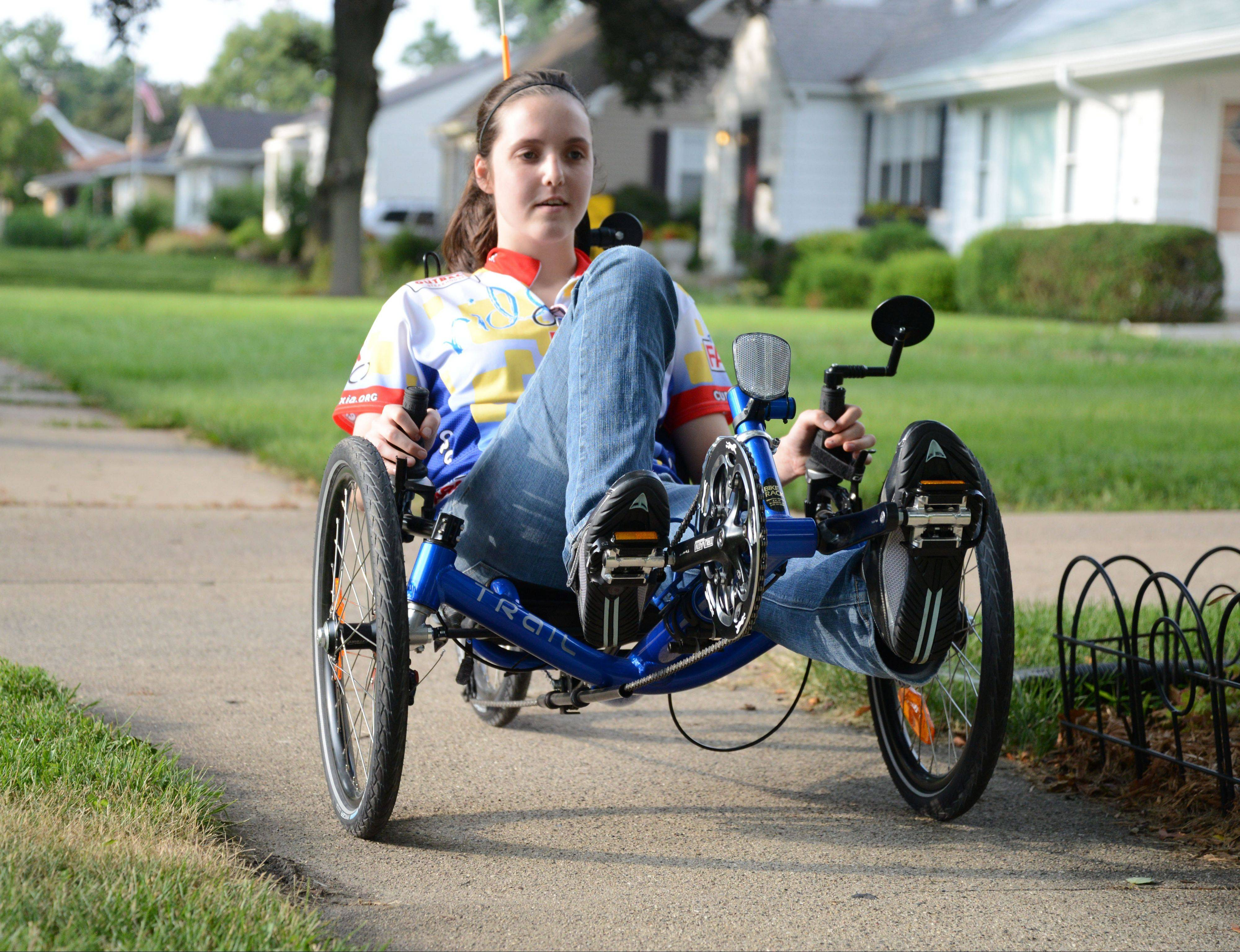 Friedreich's ataxia forces Nicole Kramer to use a walker to help with an unsteady gait, but the 19-year-old Villa Park woman finds freedom while cruising the neighborhood on her new custom cycle. She plans to ride in next Sunday's Ride Ataxia fundraiser through the southern suburbs.